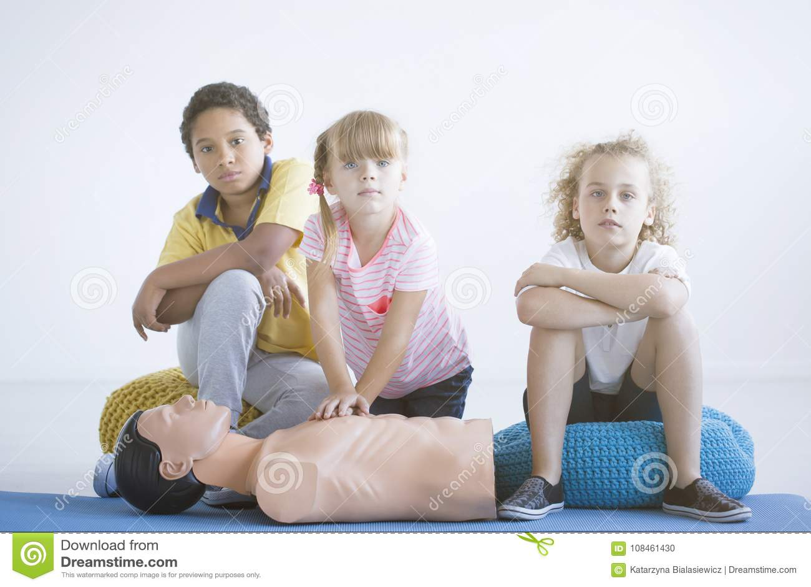 Children practicing chest compressions