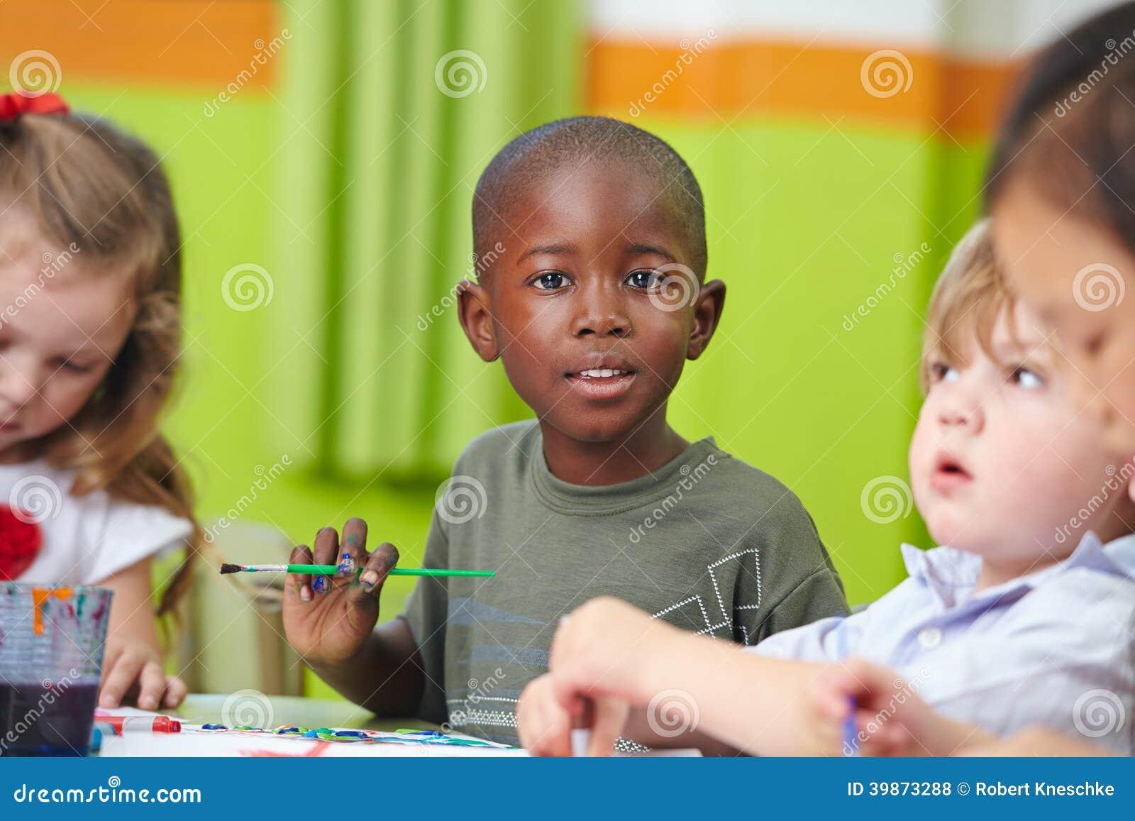 Children in preschool painting