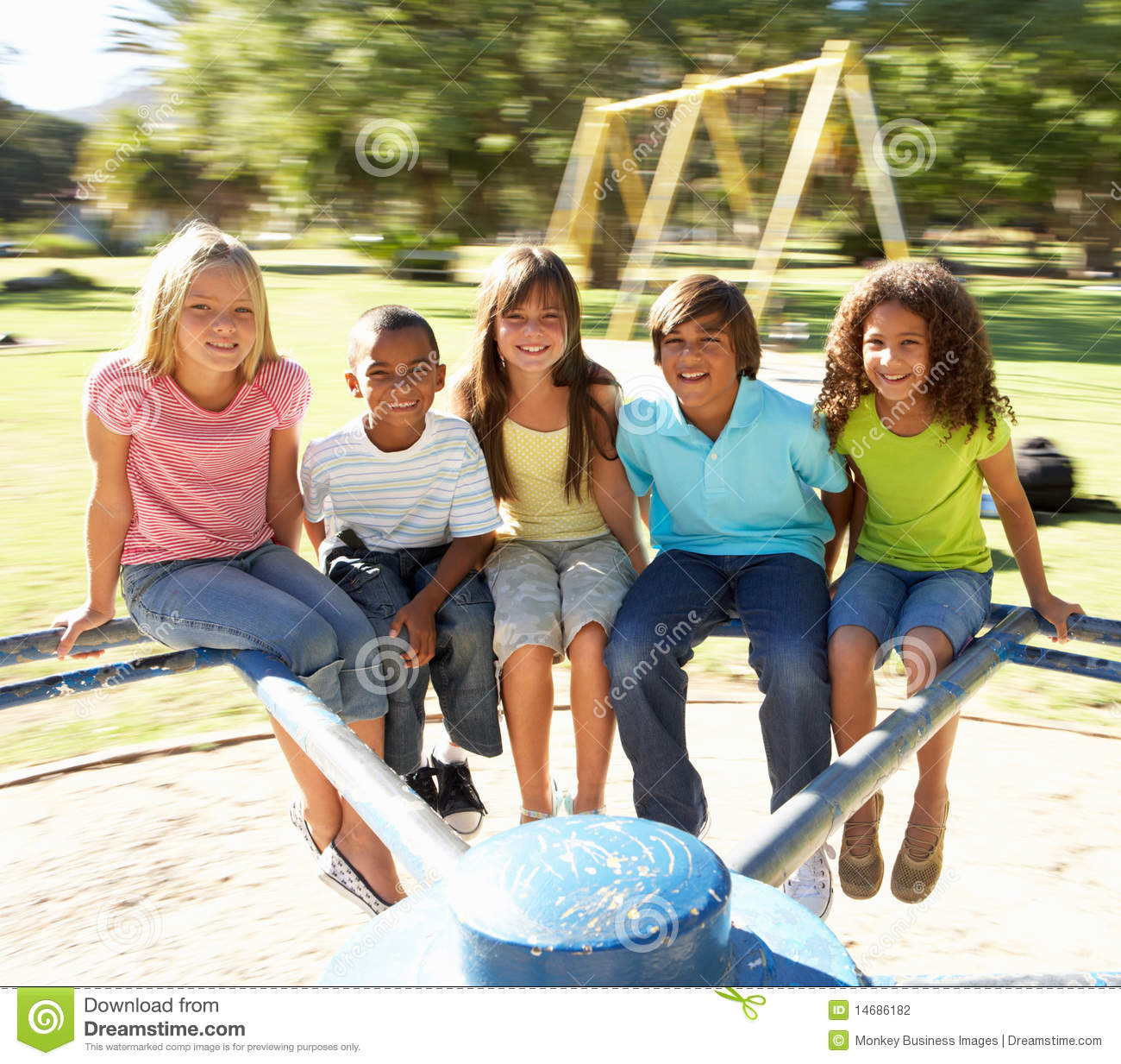 Download Children Riding On Roundabout In Playground Stock Photo - Image of outdoors, friends: 14686182