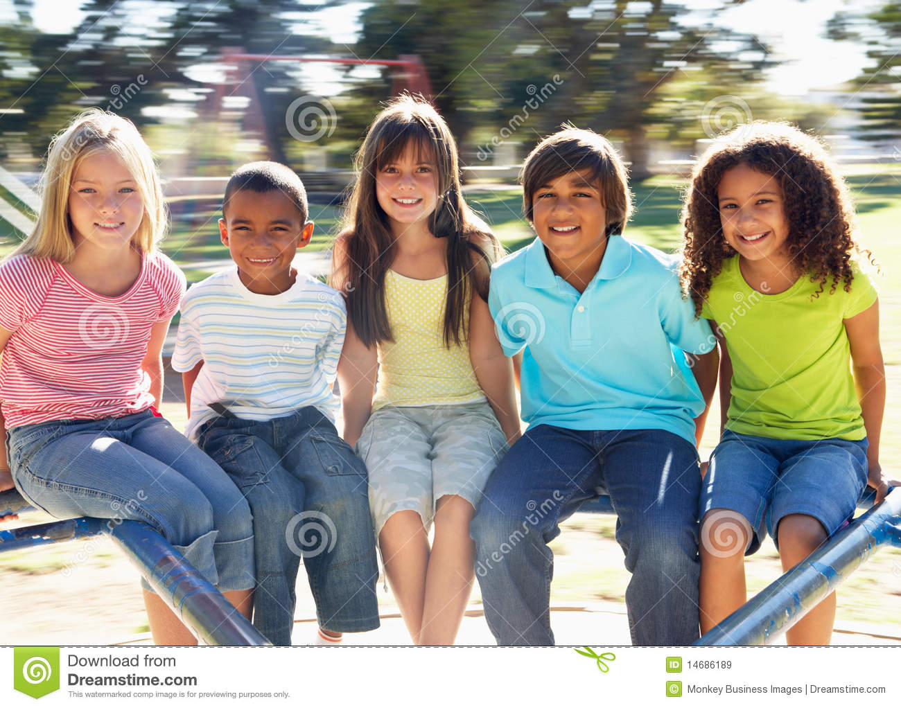 Download Children Riding On Roundabout In Playground Stock Image - Image of movement, outdoors: 14686189