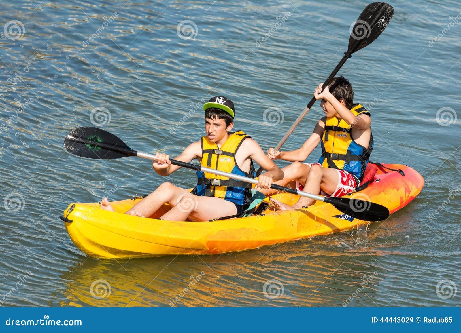 Children Rowing In Kayak
