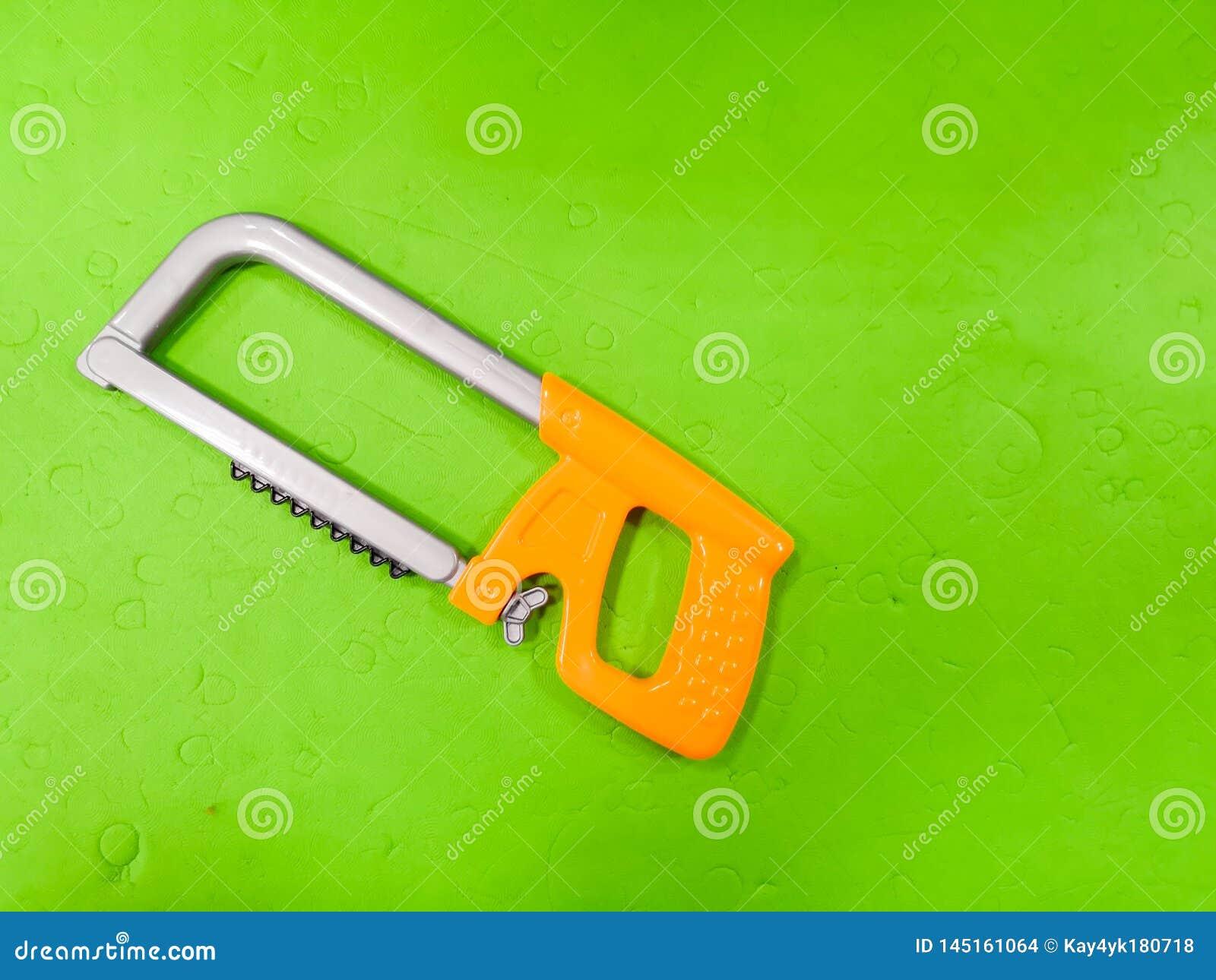 Children`s bait, on a green background. Tool for the child, repairman detsky, development for children, preparing the child for