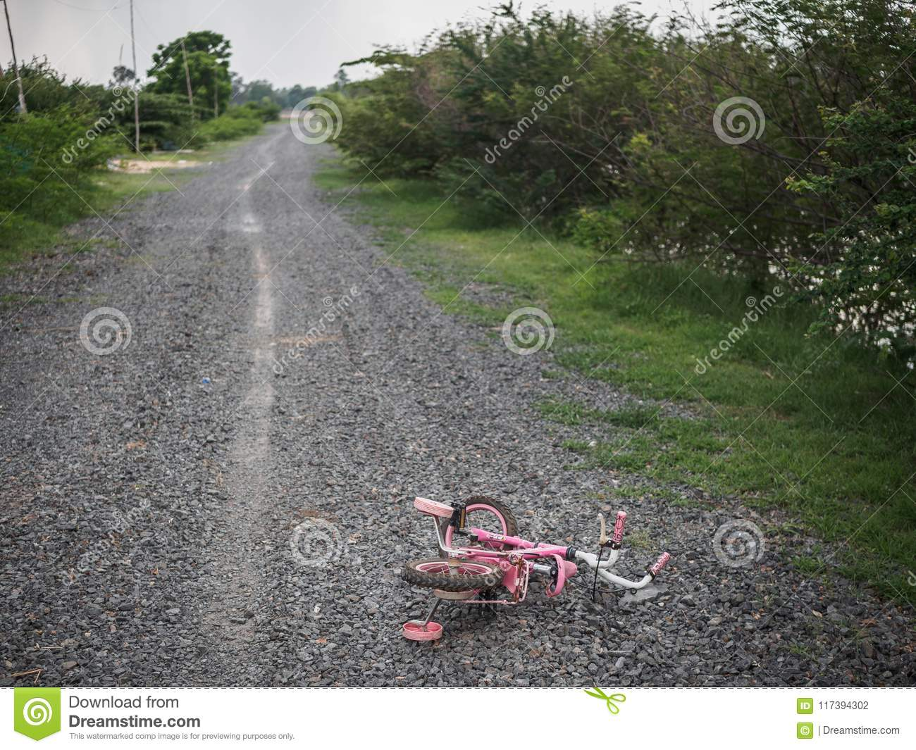 Children`s bikecycle and shoe on stone road. missing children co