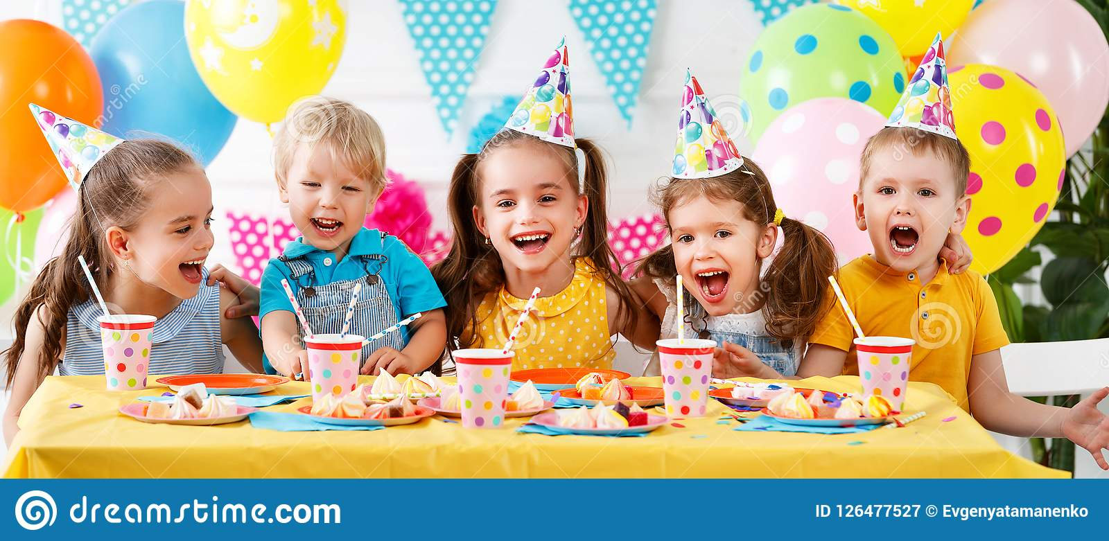 Children`s birthday. happy kids with cake