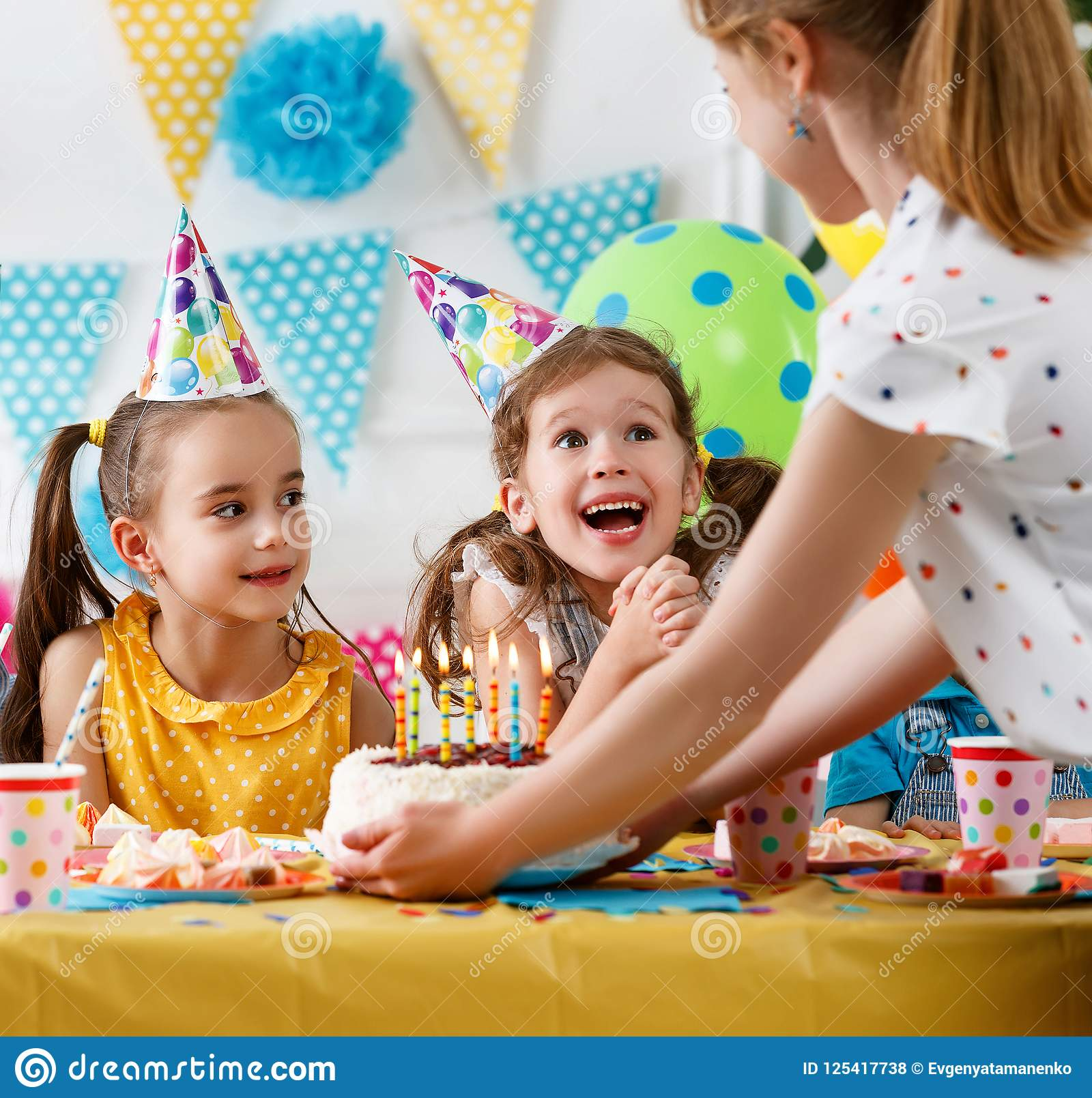 Children`s birthday. happy kids with cake