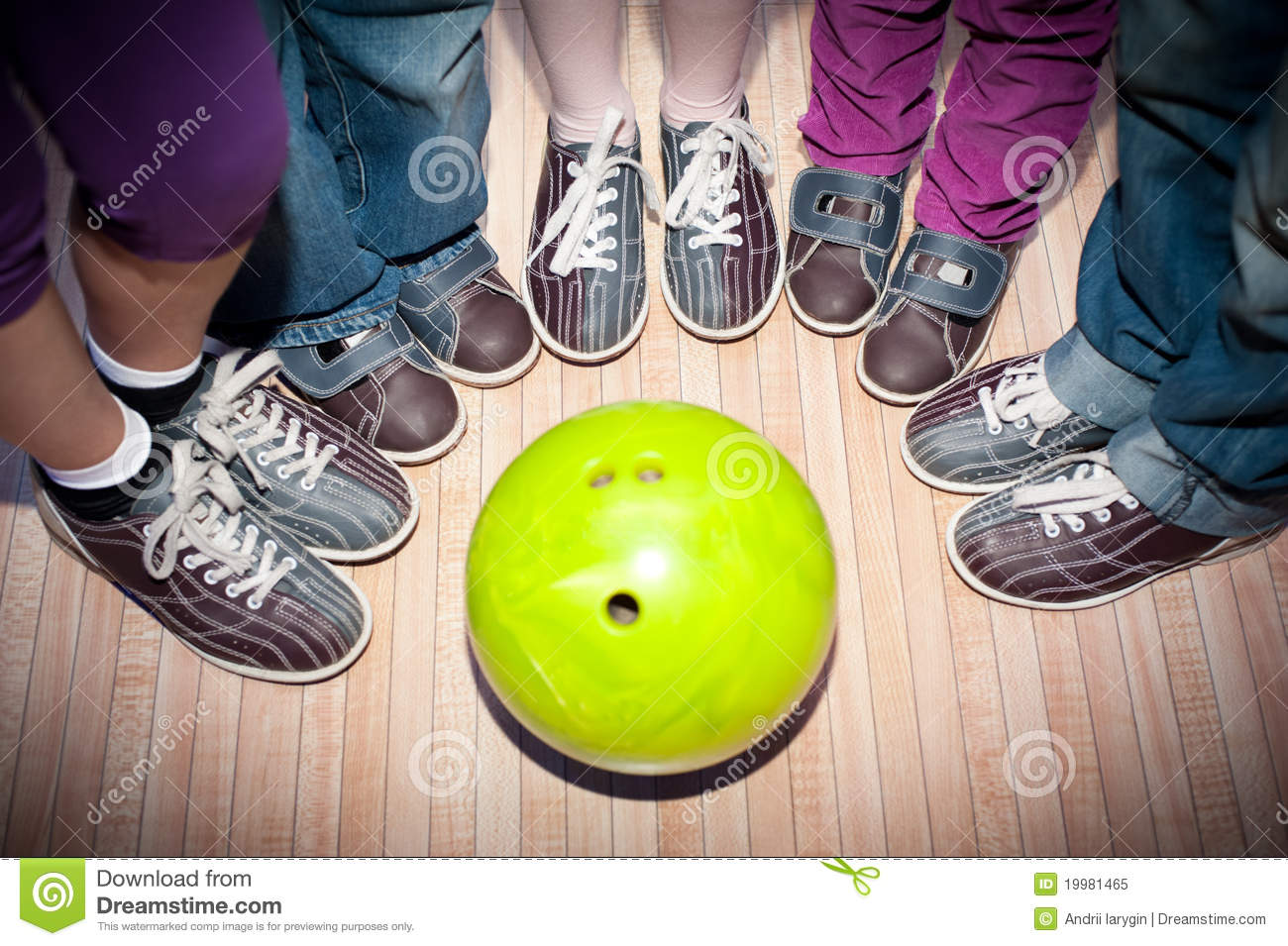 Children s feet in shoes and a bowling ball for the game