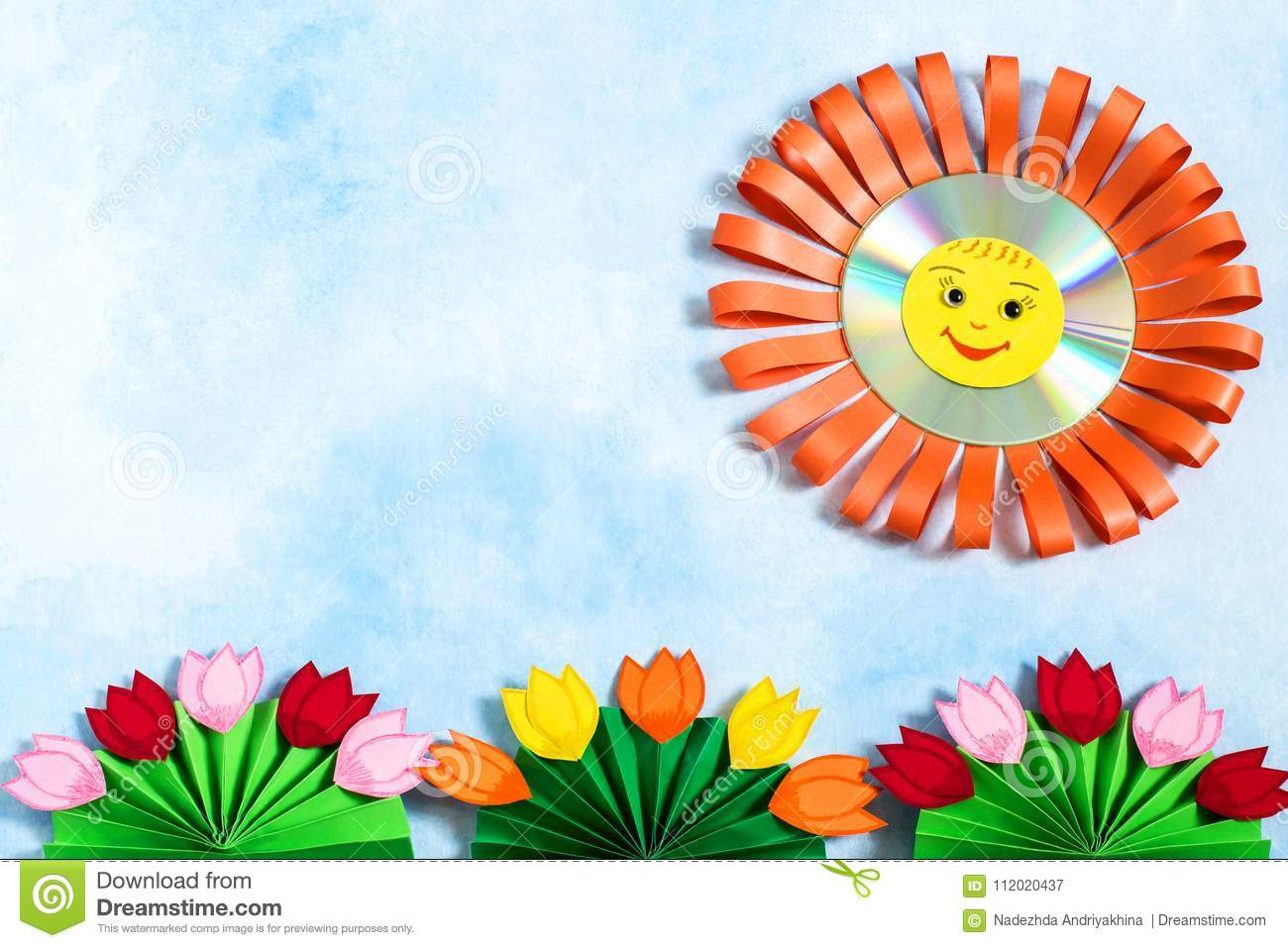 Childrens Crafts Made Of Paper And Cd Sun And Flowers Stock Image