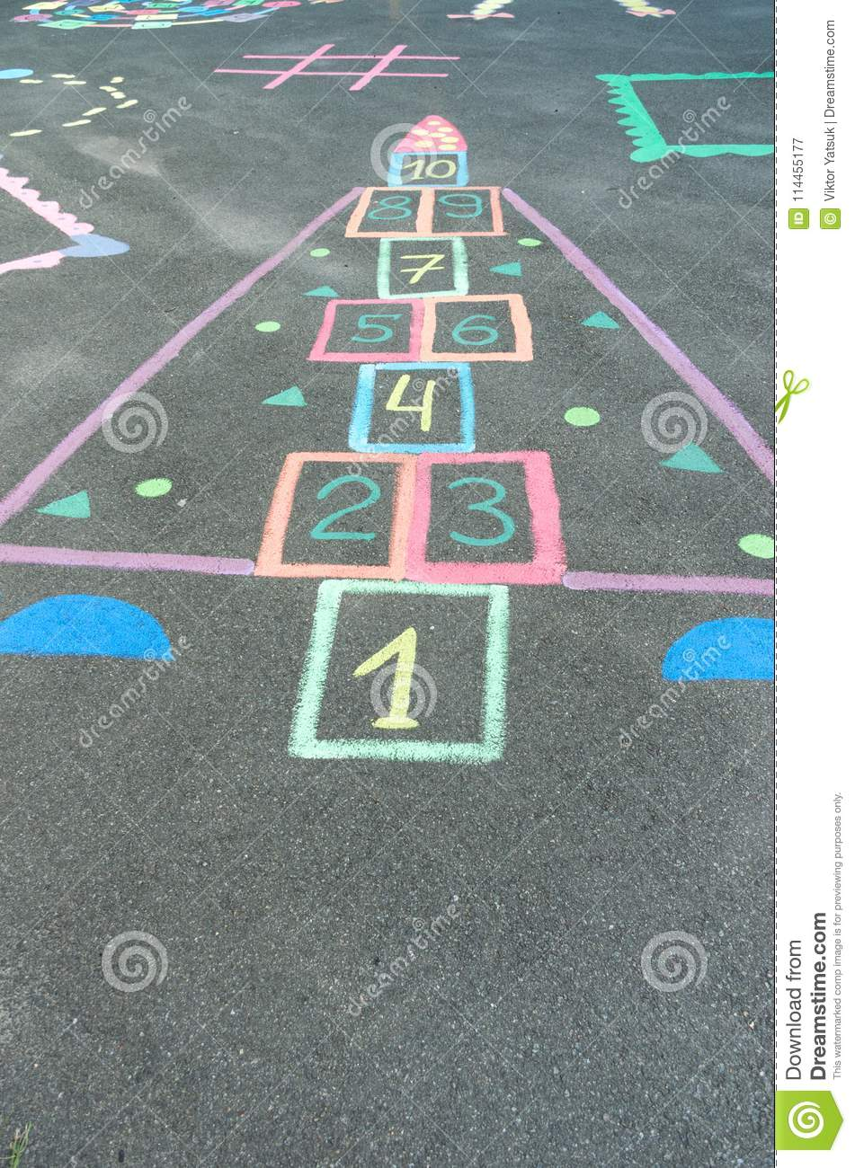 Children`s drawings on the asphalt. Drawings with colorful crayons.