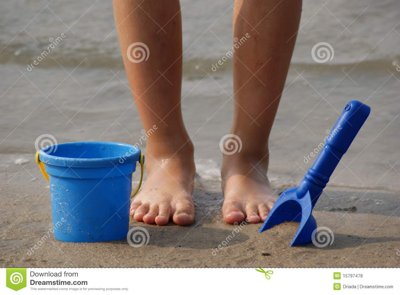 Toys For Feet : Children s feet with beach toys royalty free stock photos
