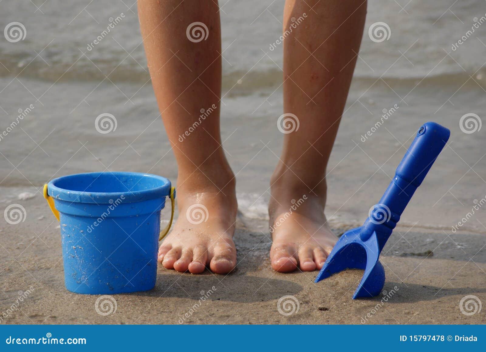 Toys For Feet : Children s feet with beach toys royalty free stock photos