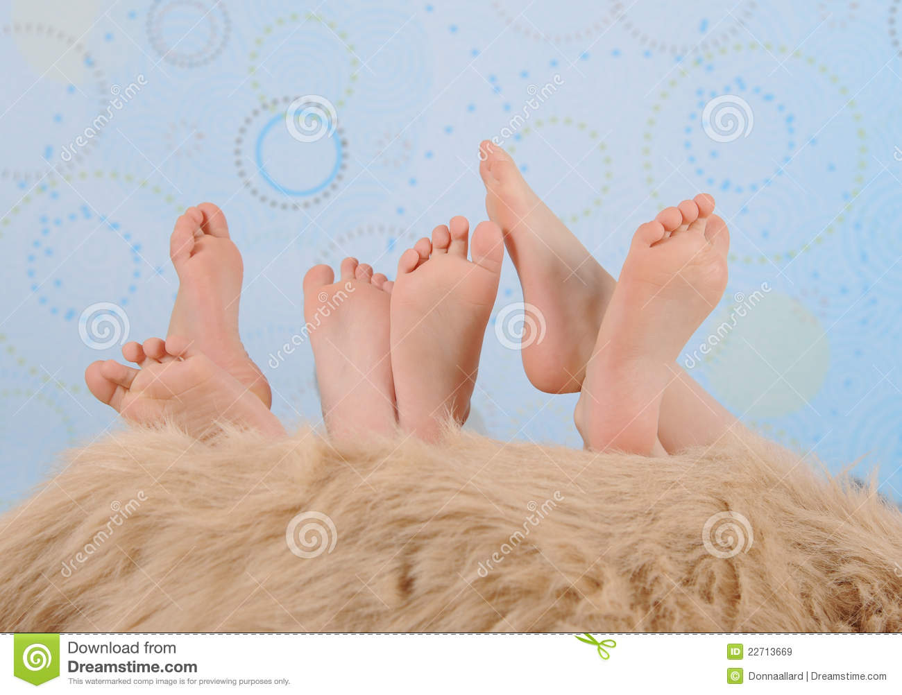 Children S Feet Over Furry Blanket Royalty Free Stock