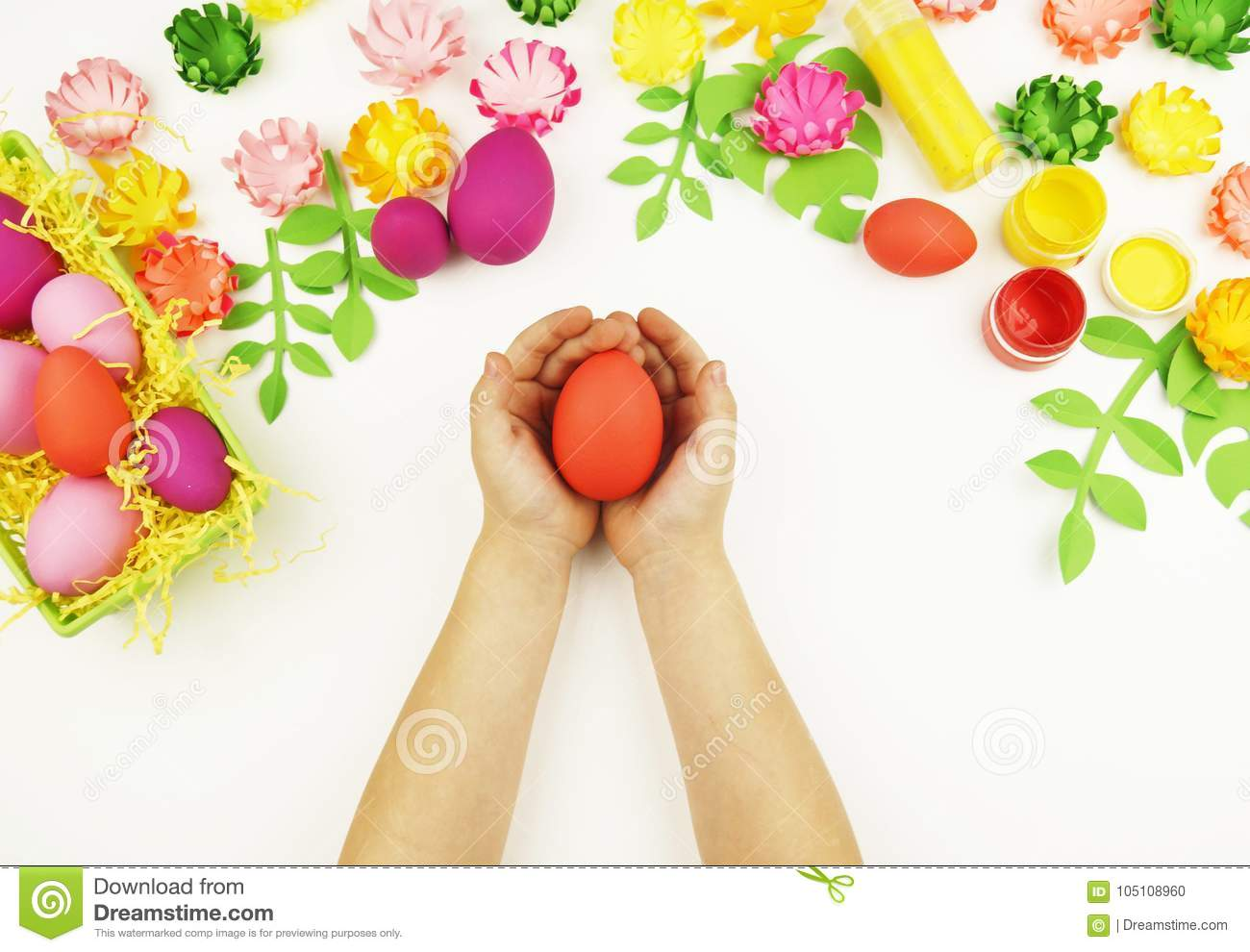 Childrens hands hold an easter egg easter spring childrens childrens hands hold an easter egg easter spring childrens creativity easter preparation for the easter partyper flowers and leaves mightylinksfo