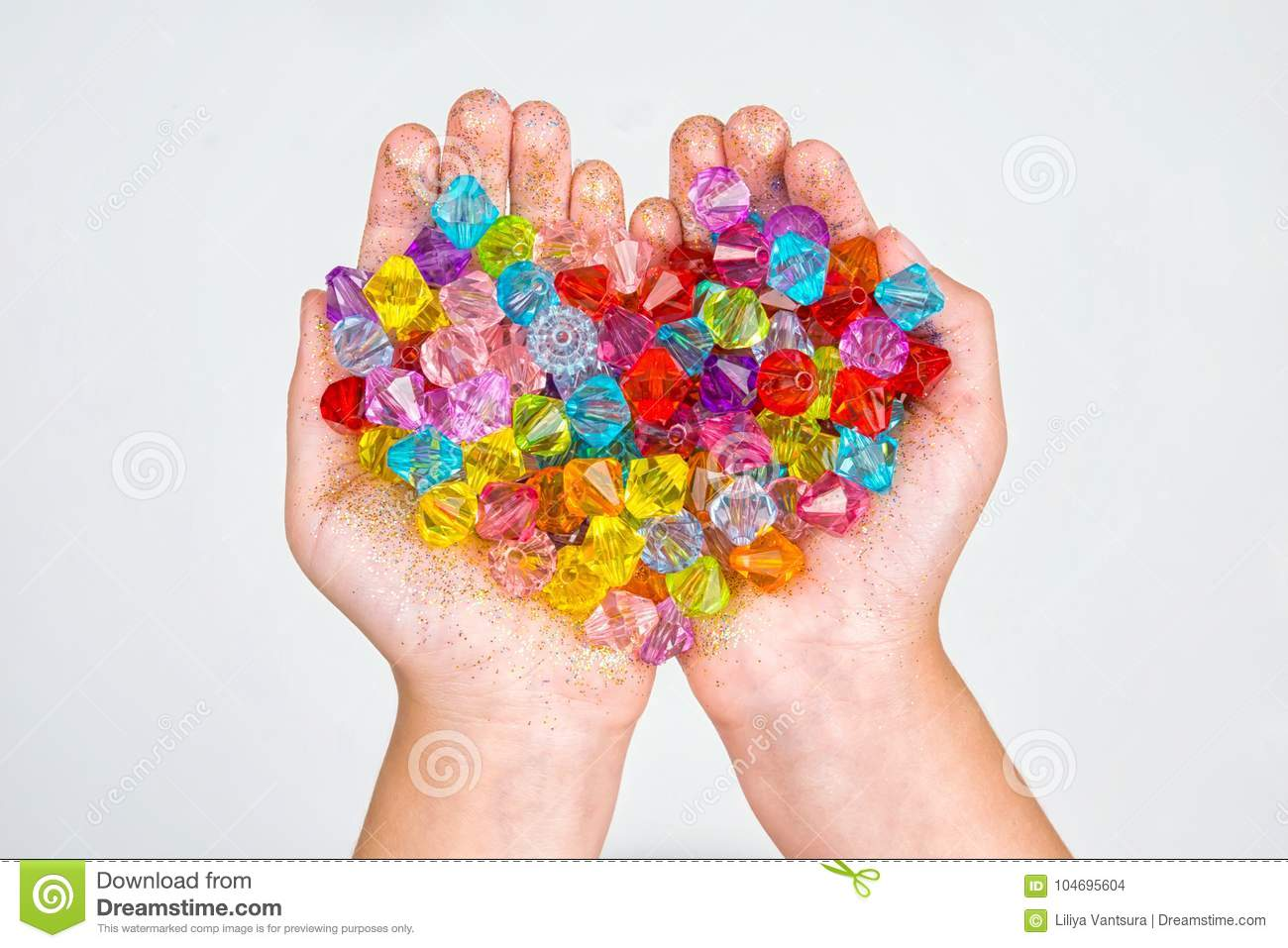 Children`s hands, hands holding beads on a white background