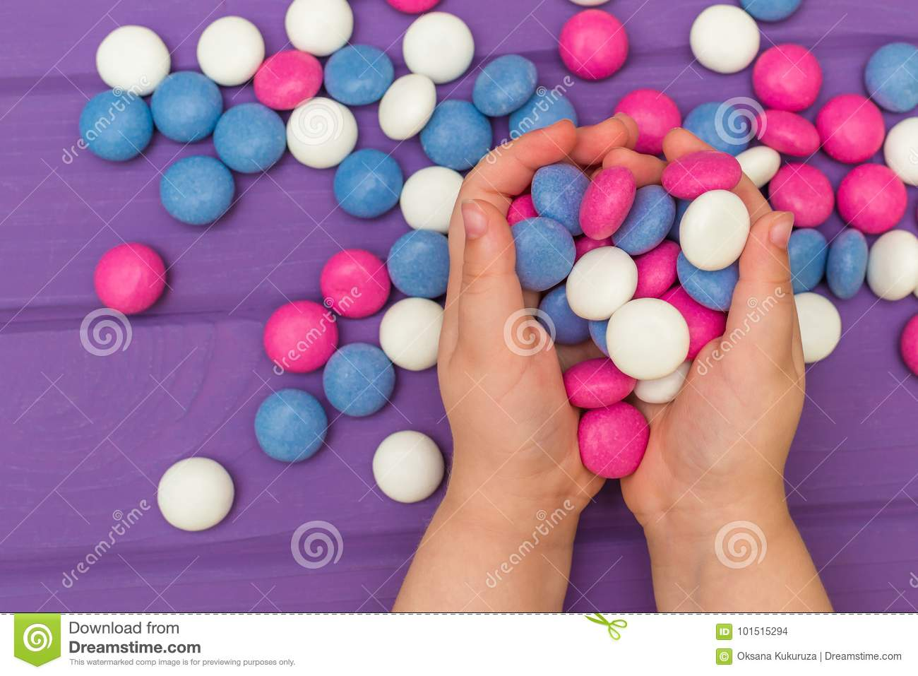 children s hands holding colored candies stock photo image of