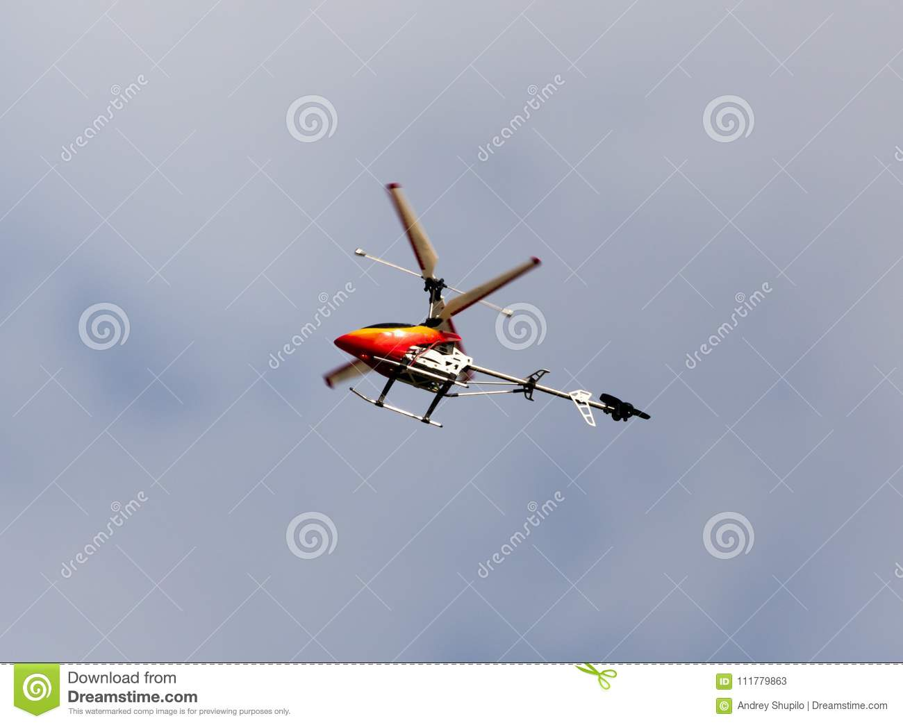 Children`s helicopter in the sky