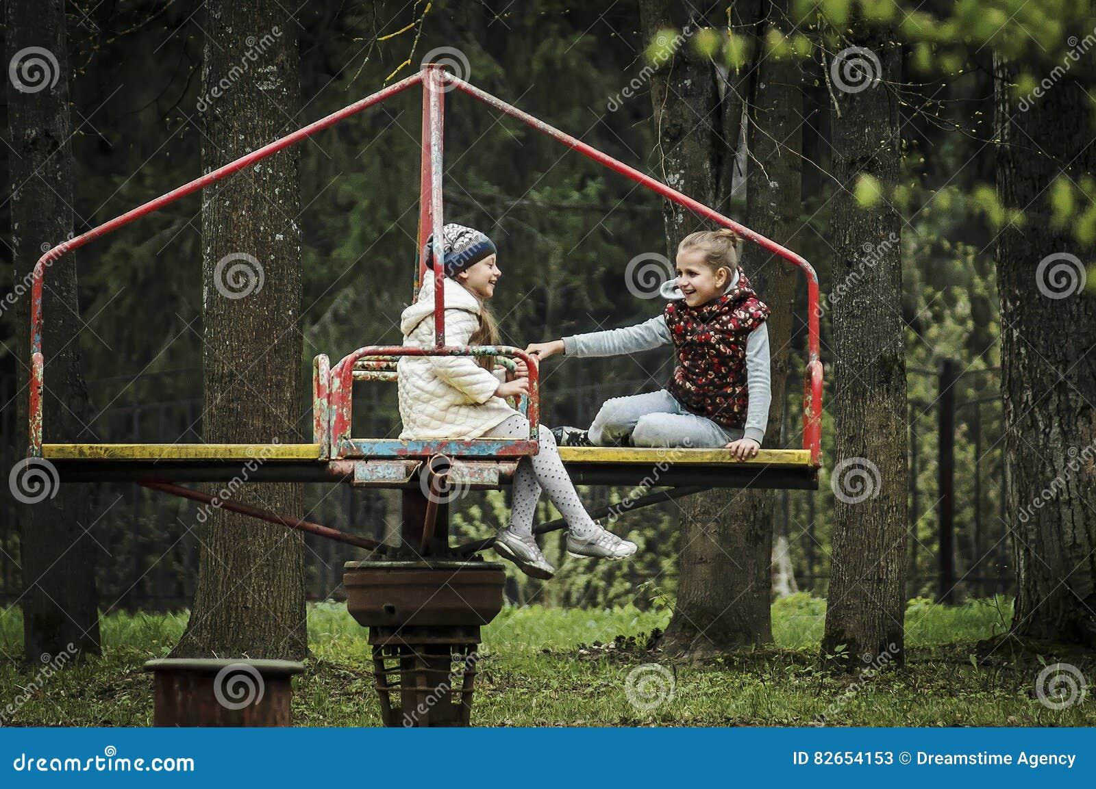 Children`s joy on the carousel.