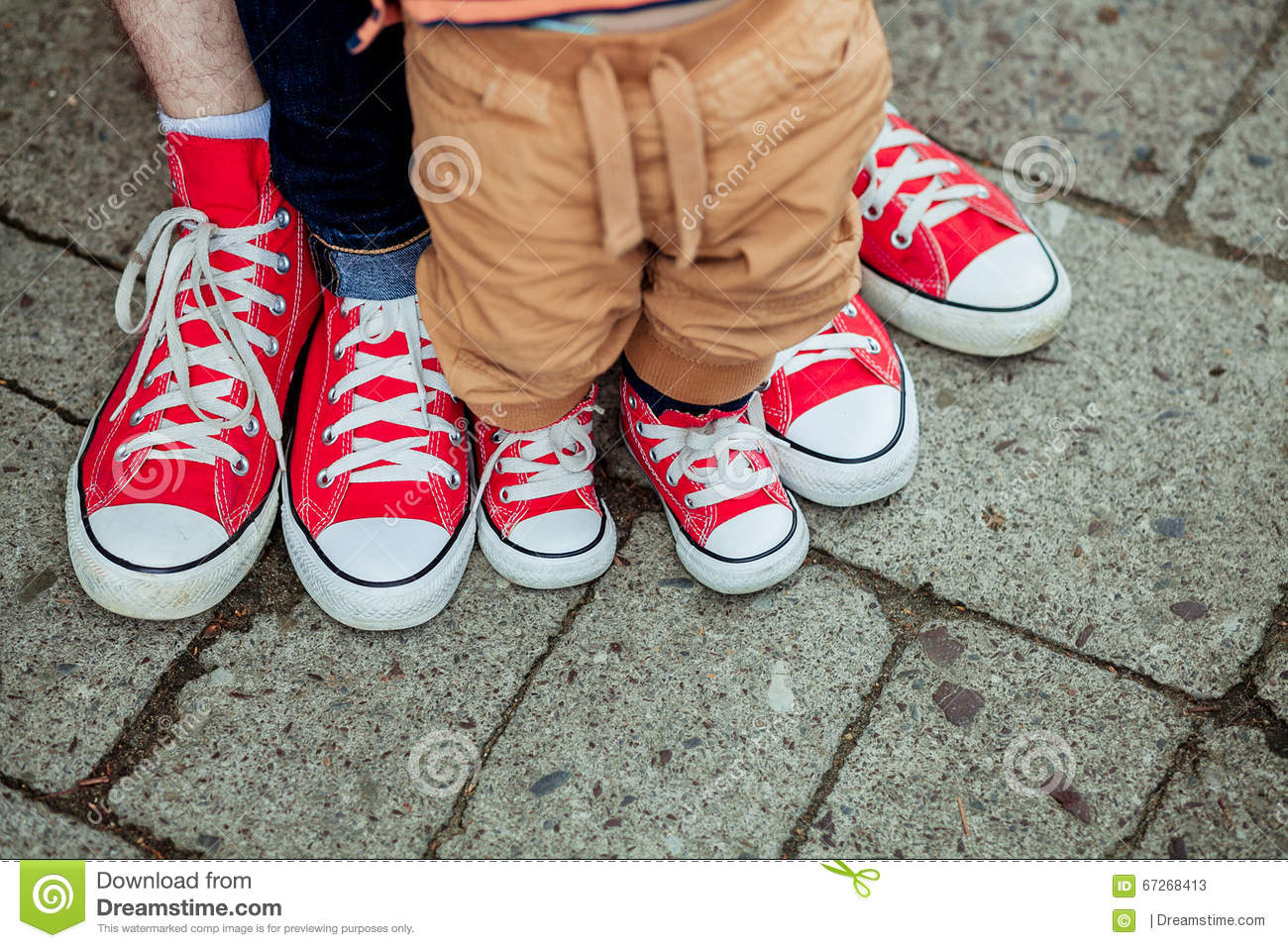 Children's Legs And Feet In Sneakers Stock Photo