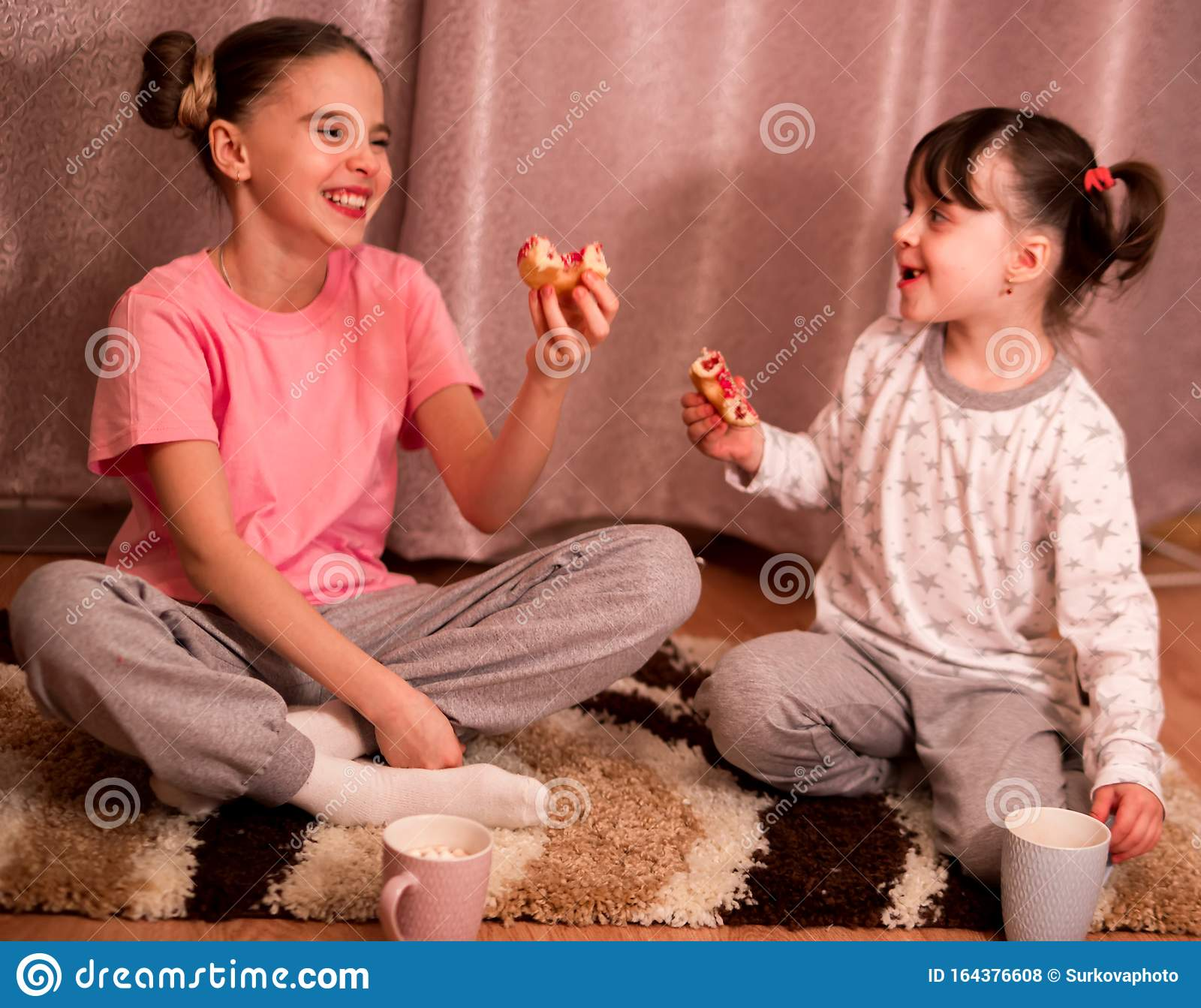 Children S Pajama Party Funny Girls In Pink White And Gray Pajamas With Bob Hairstyles Eat Donuts And Laugh Stock Photo Image Of Friends Hairstyle 164376608