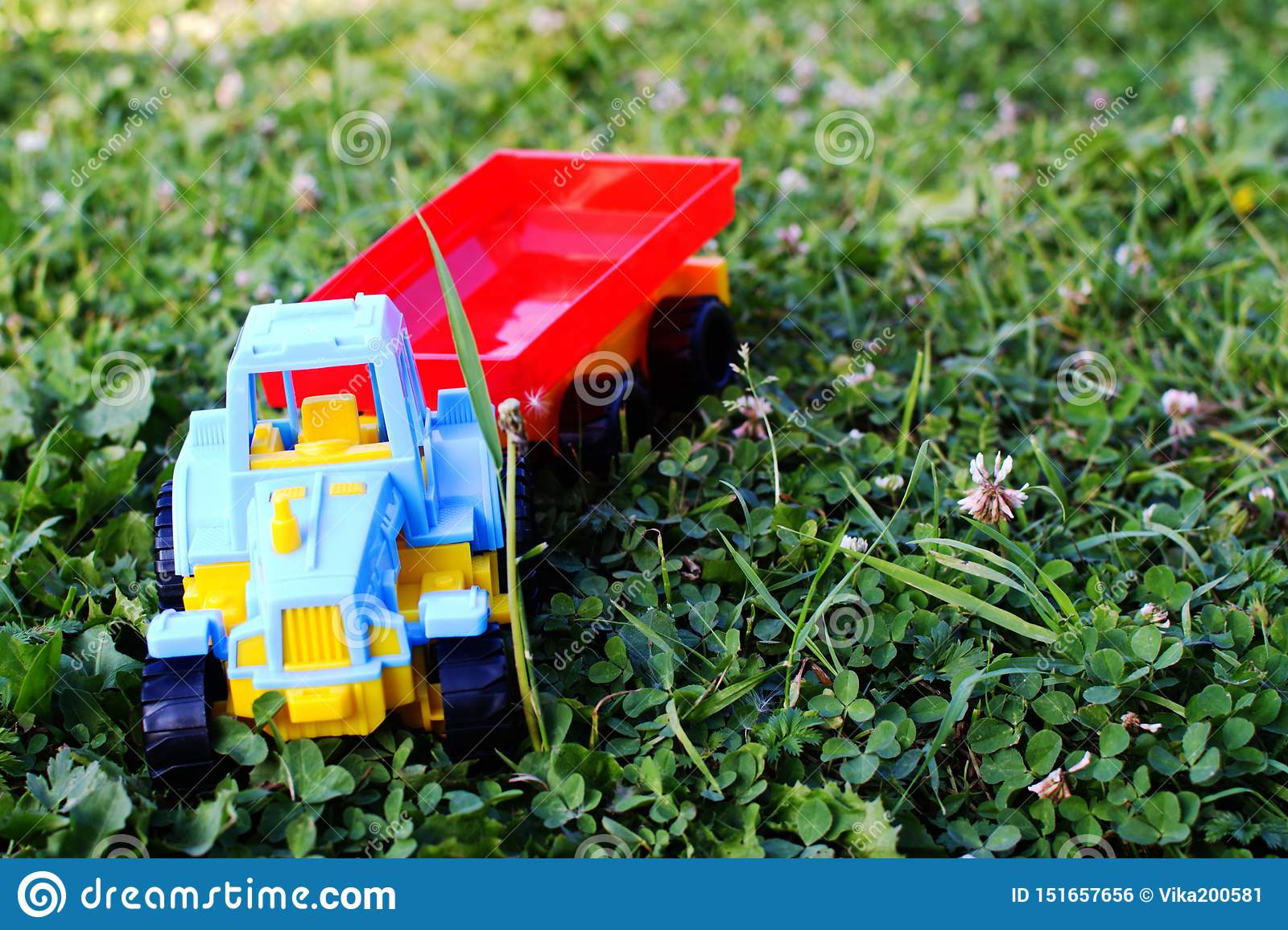 Children`s plastic toy the tractor