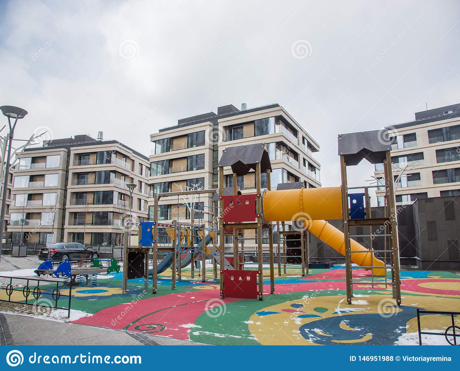Children`s playground in the courtyard of a residential area