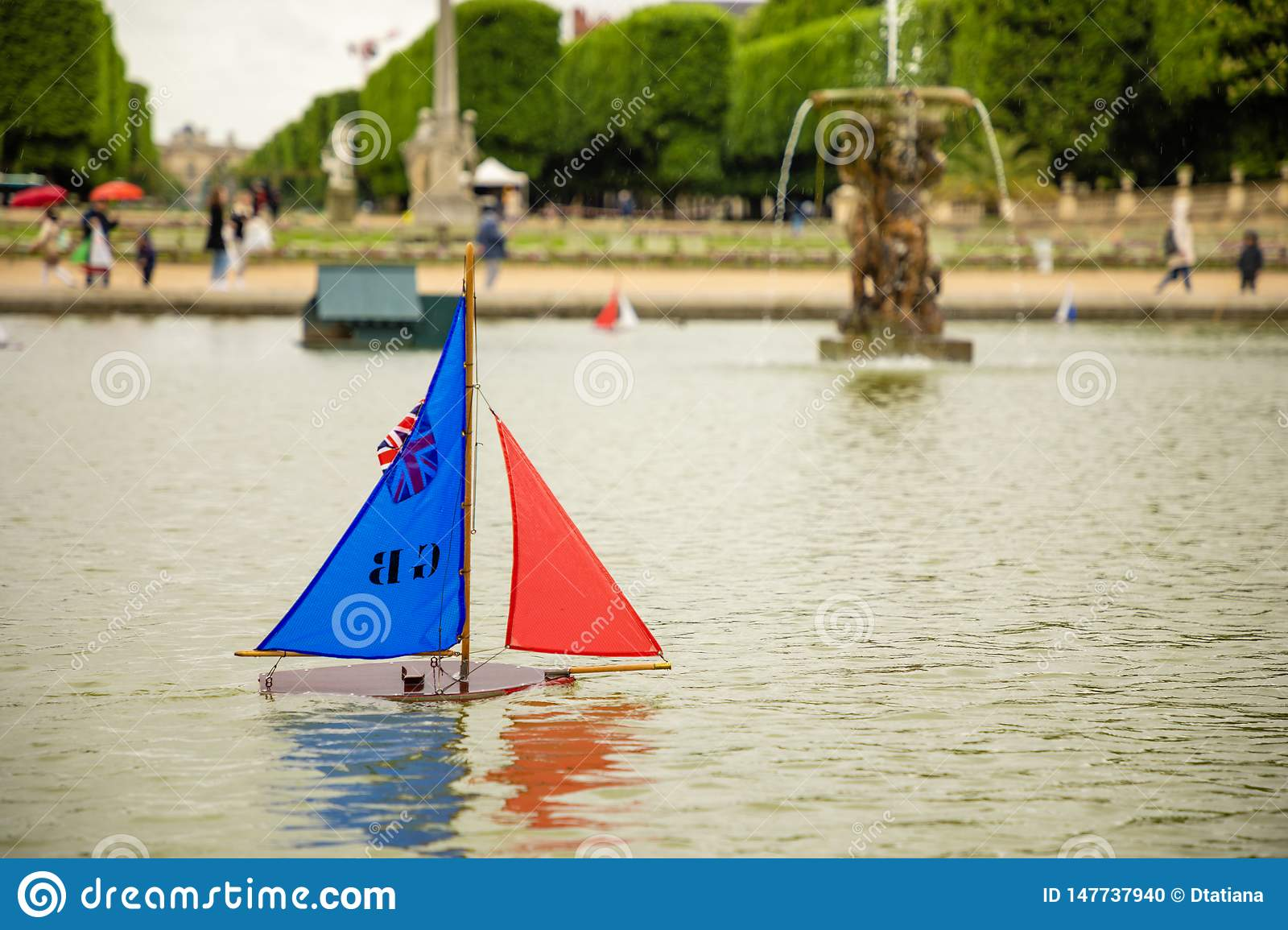 Children`s ships in fountain near Luxembourg Palace in the Luxembourg Garden in Paris, France