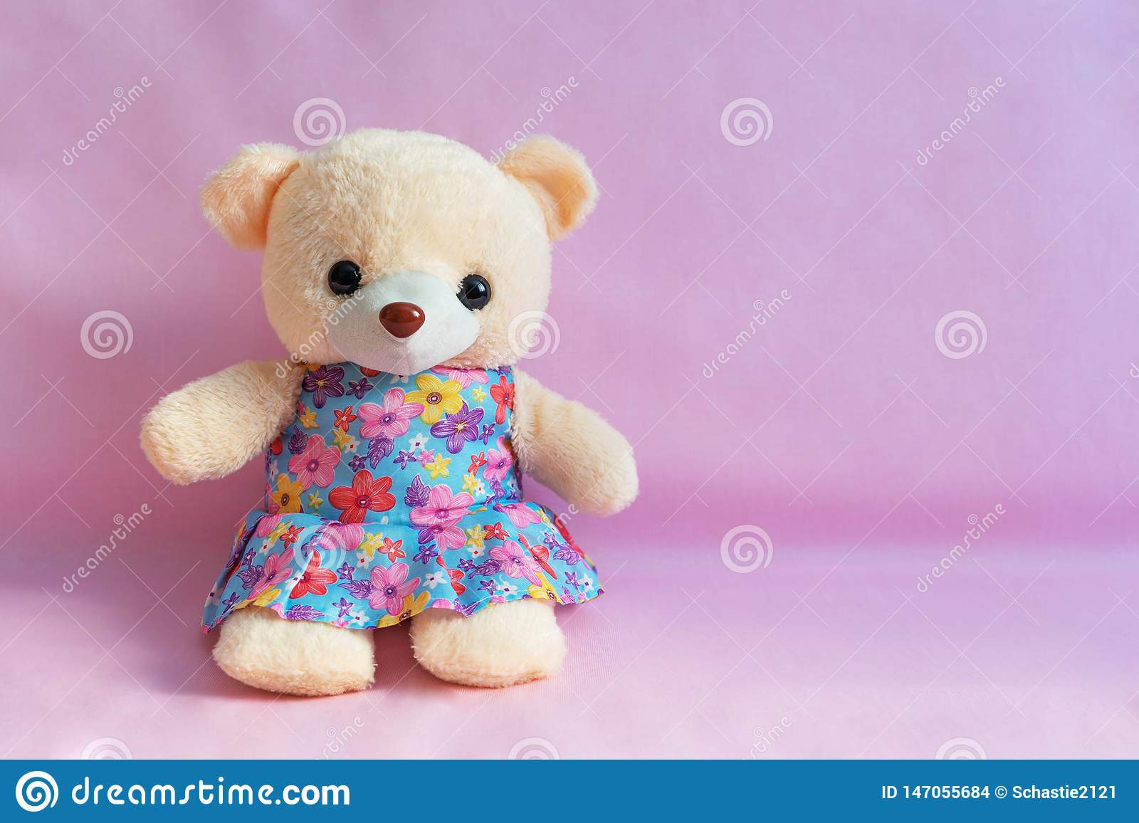 children`s toy bear on a pink background.