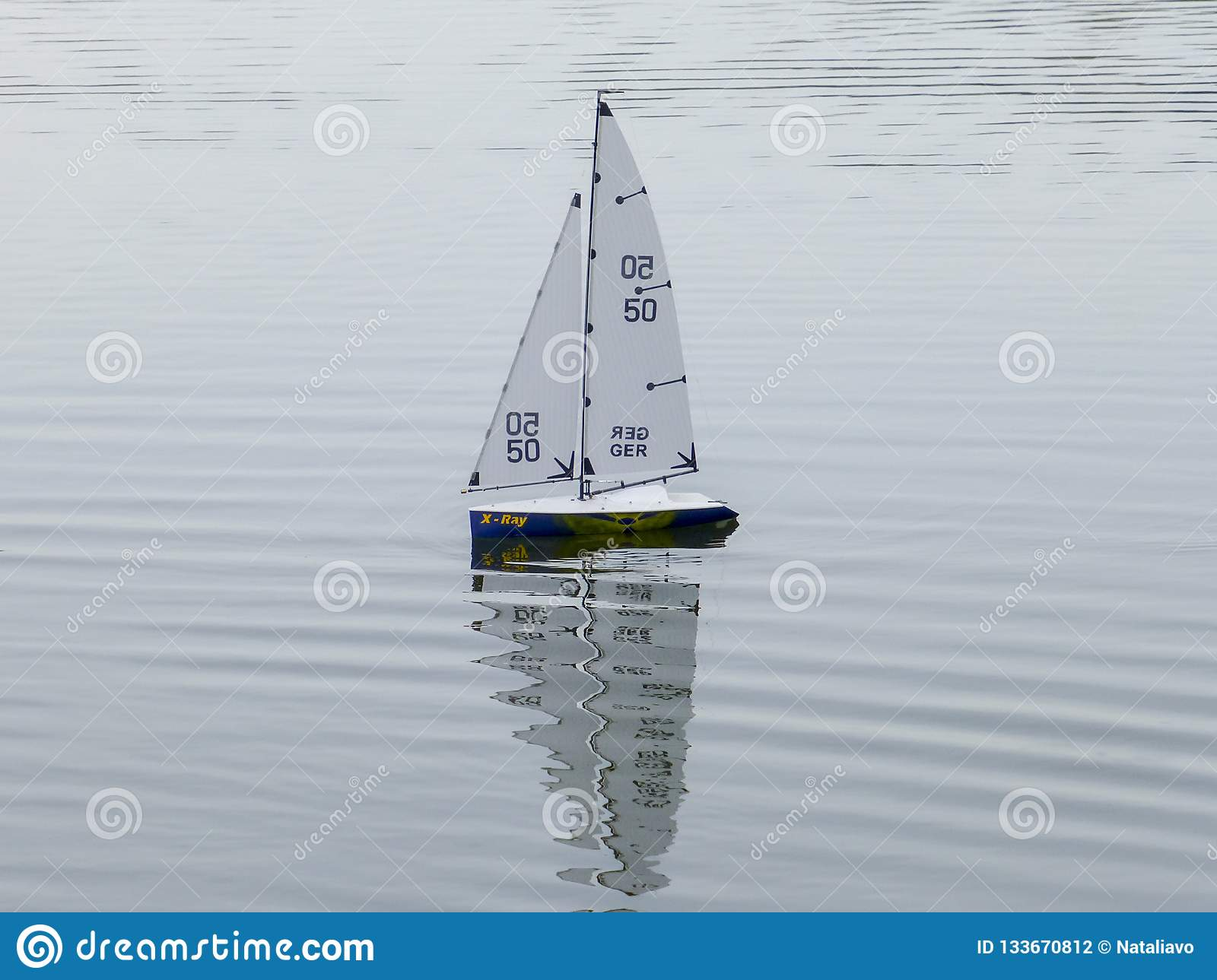 Children`s Toy Sailboats On The Water  Close Up Stock Photo