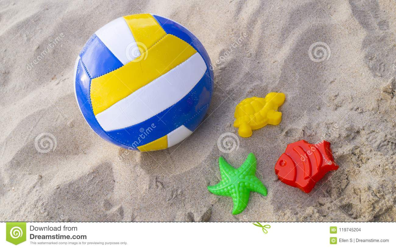Children`s Toys On The Sand, Soccer Ball And Colorful Sand