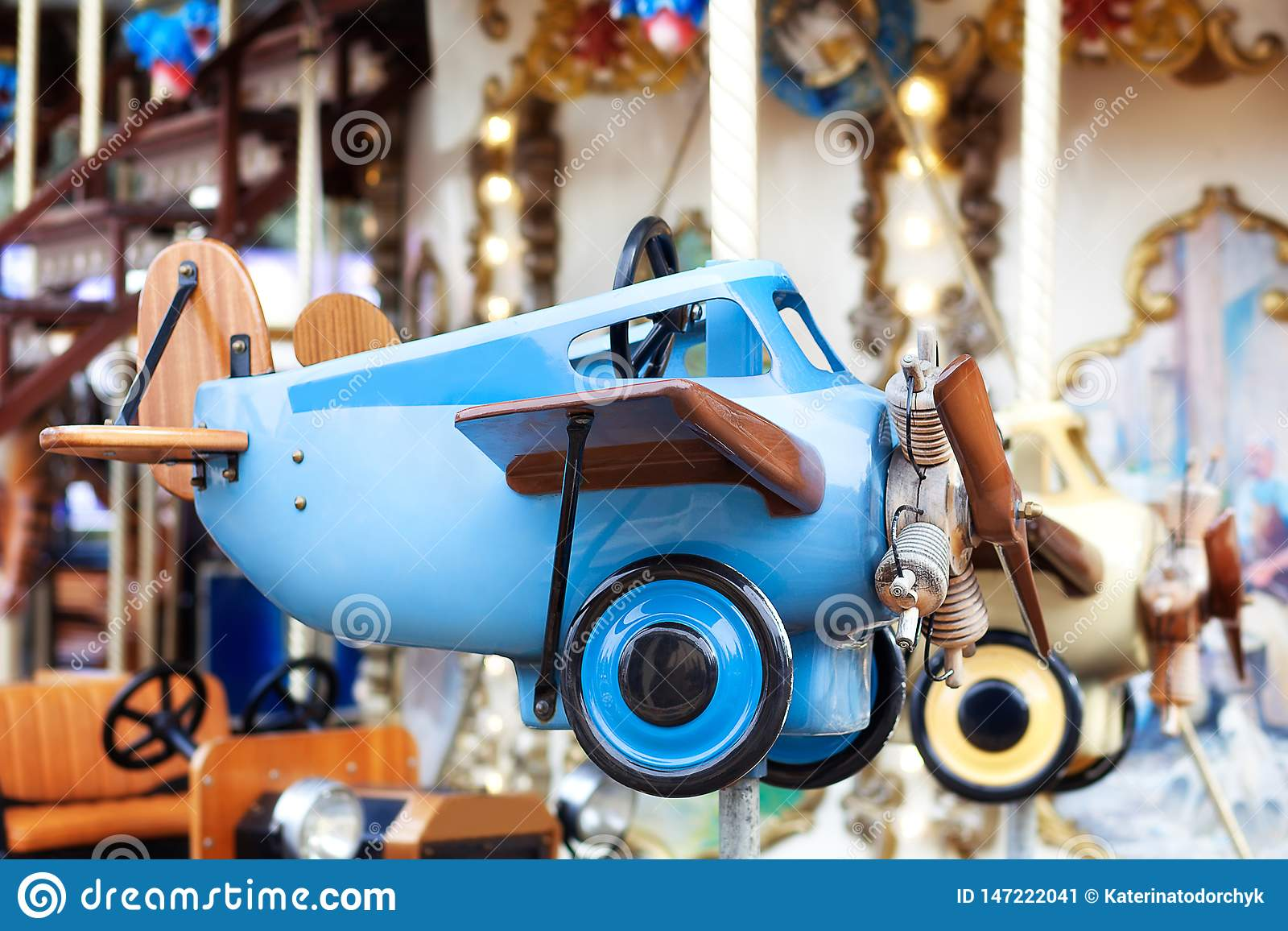 Children`s vintage blue plane. Children`s carousel. Kids toys. Little pilot. Retro plane.old plane, biplane. Aviation Day.