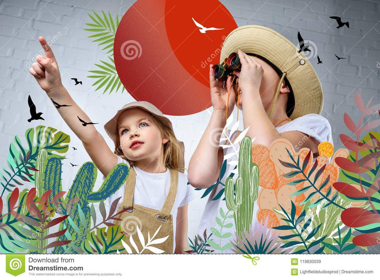 children in safari costumes and hats pointing and looking in binoculars at birds