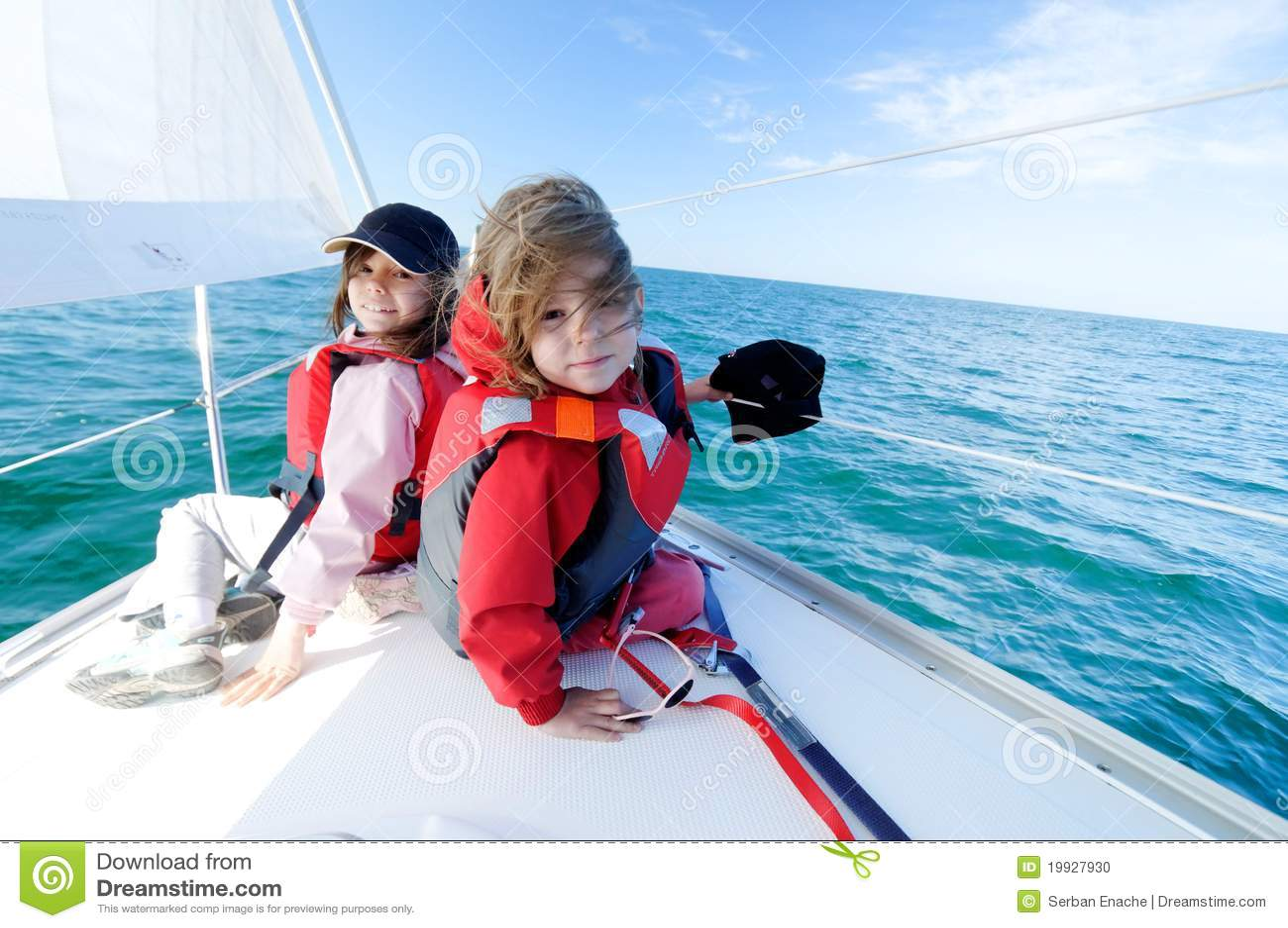 Children sailing on yacht