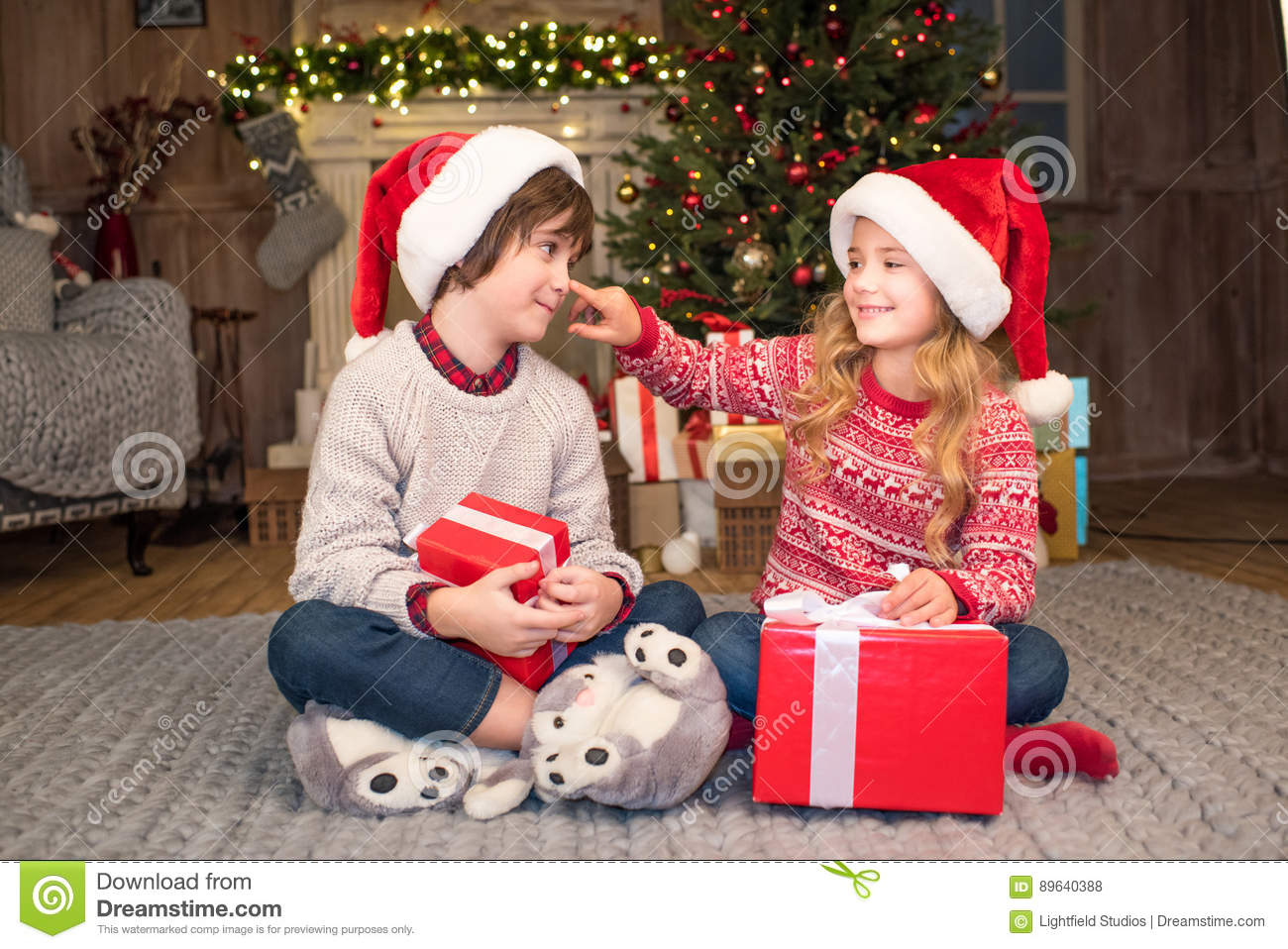 Children In Santa Hats With Christmas Gifts Stock Photo - Image of ...