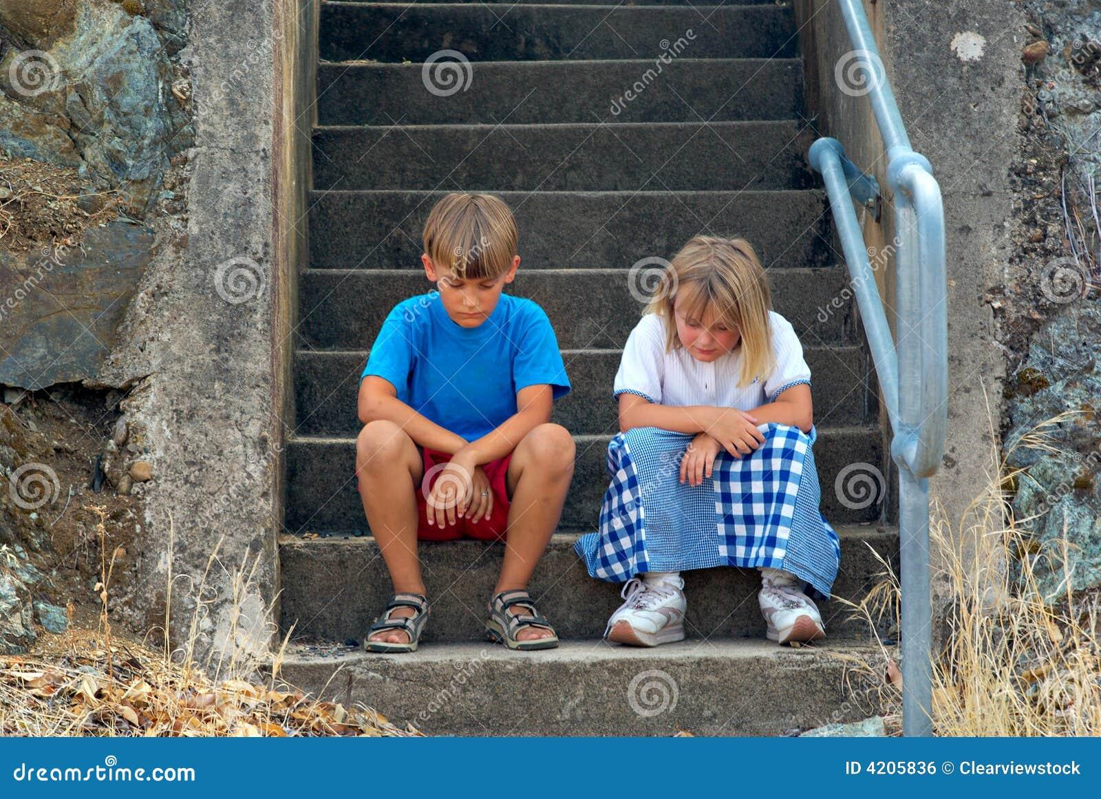 children Sitting on the steps