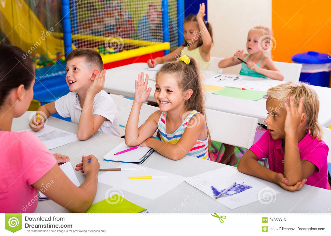 Children sitting together and studying in class at school