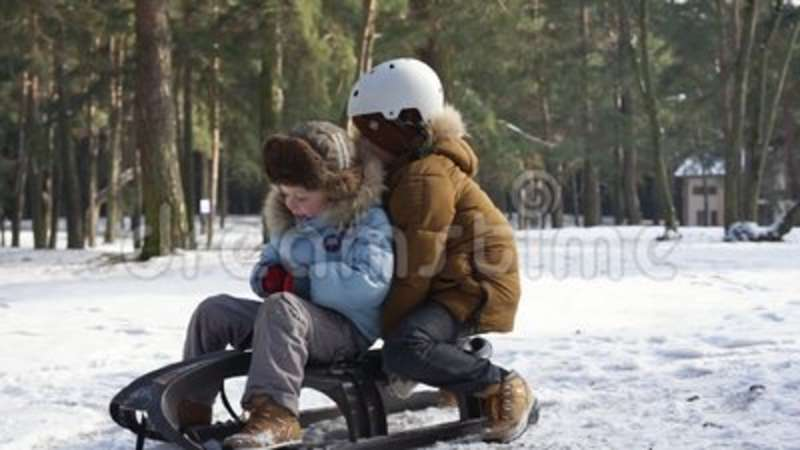 children sledding on snow active fun for family christmas vacation stock video video of having leisure 119359773 - Christmas Vacation Sled