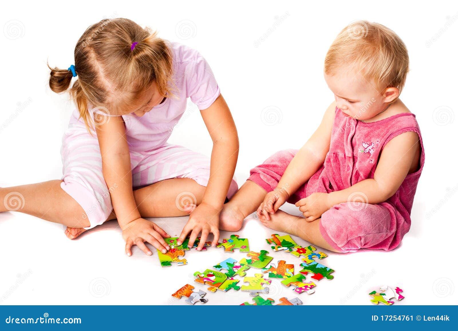 Children Solving Jigsaw Puzzle Stock Image - Image: 17254761