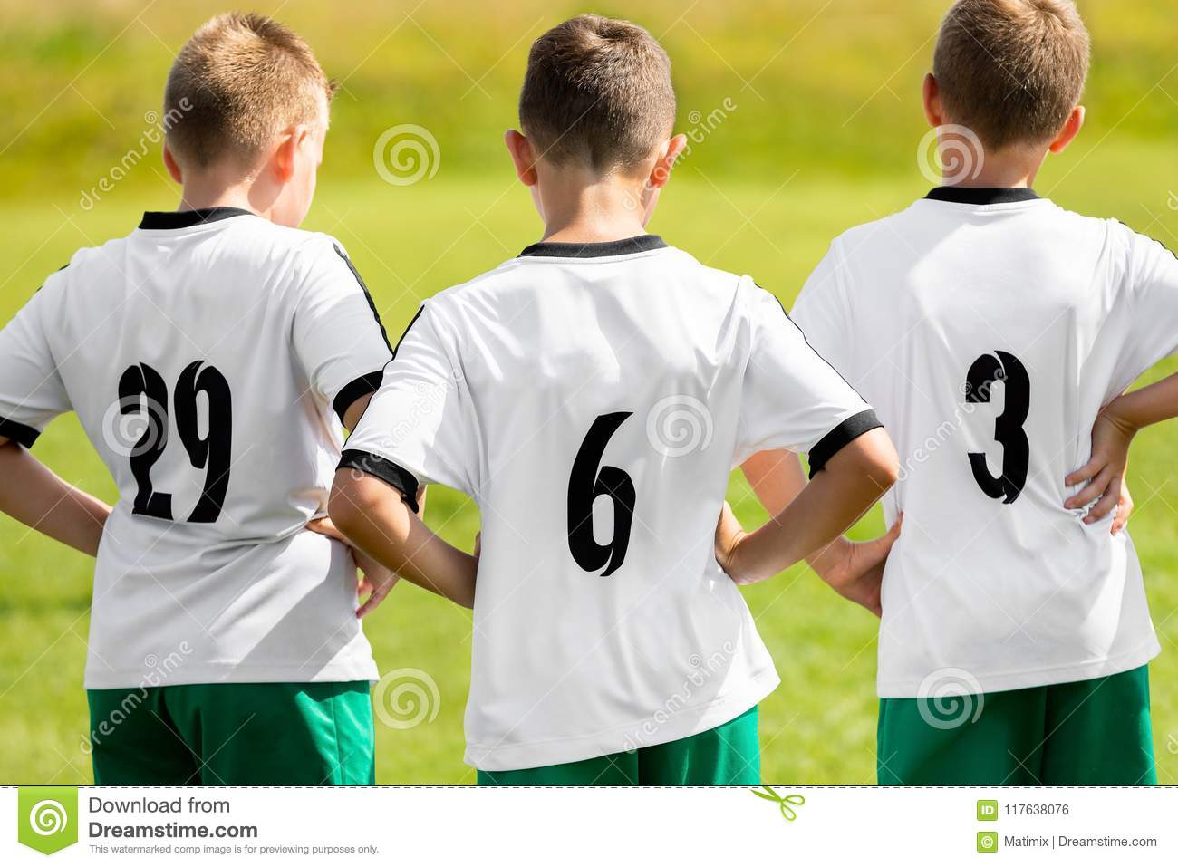 684ca2856fe Children Sports Team Wearing White Soccer Jersey Shirts. Young Boys  Watching Soccer Match. Football