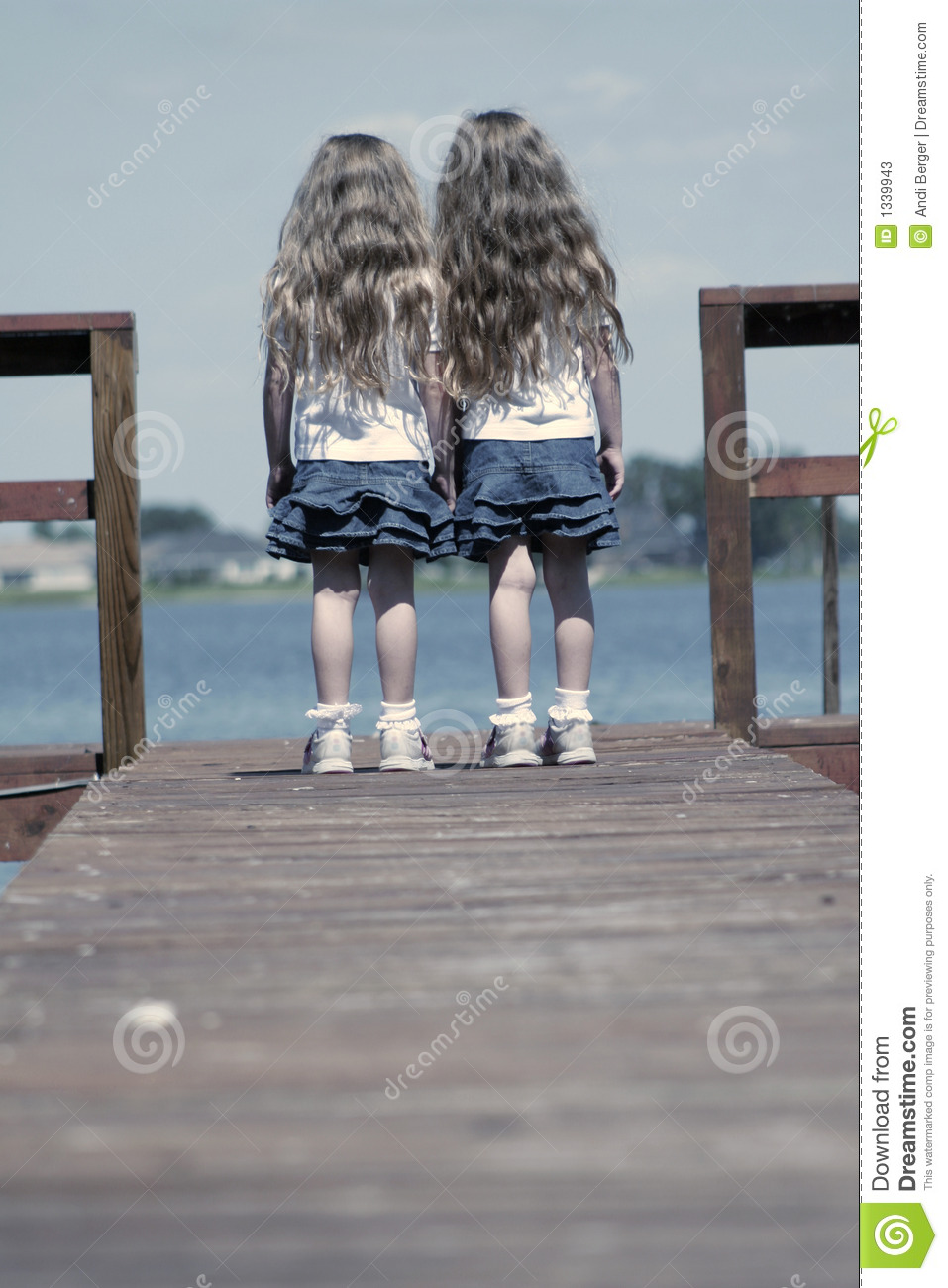 Children standing on end of dock