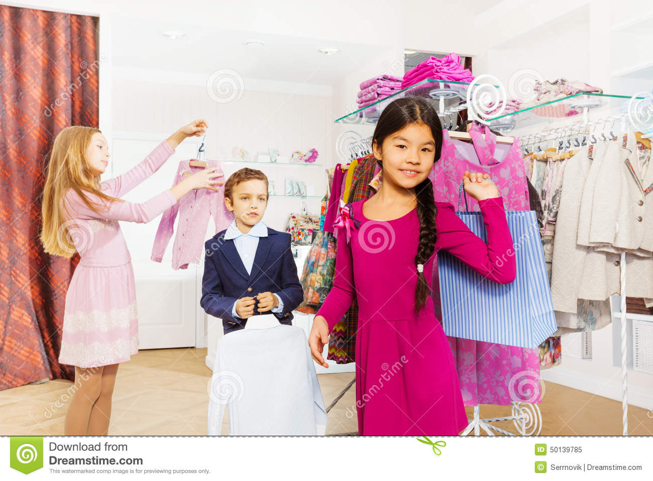 1ef7c85fc4f2 Children Standing Together In The Clothing Store Stock Image - Image ...