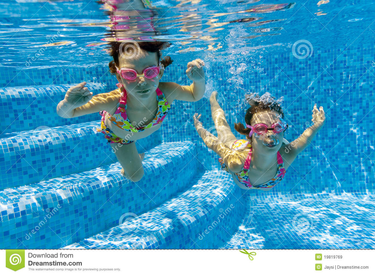 Royalty Free Stock Images: Children swimming underwater in pool