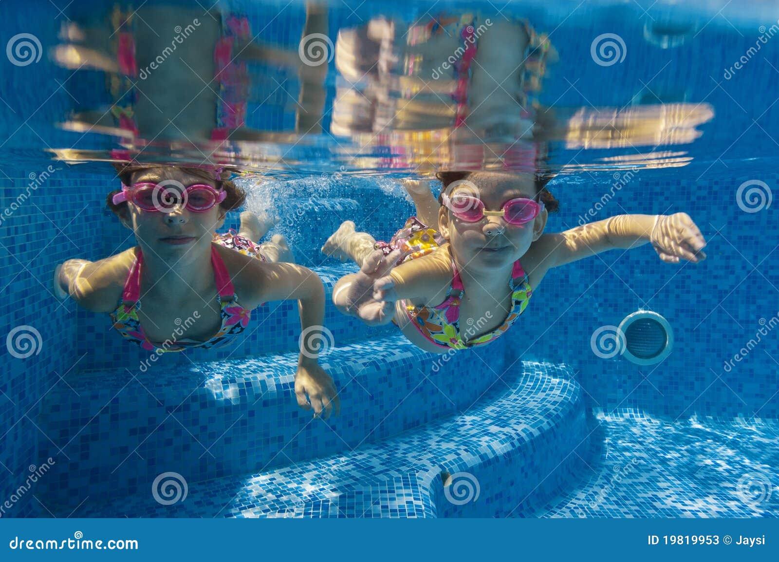 Kids swimming underwater children swimming underwater