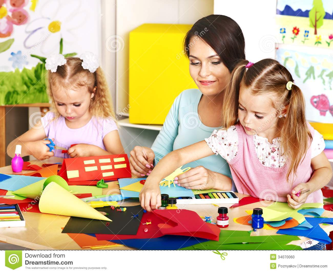 Children With Teacher At Classroom Stock Photo Image