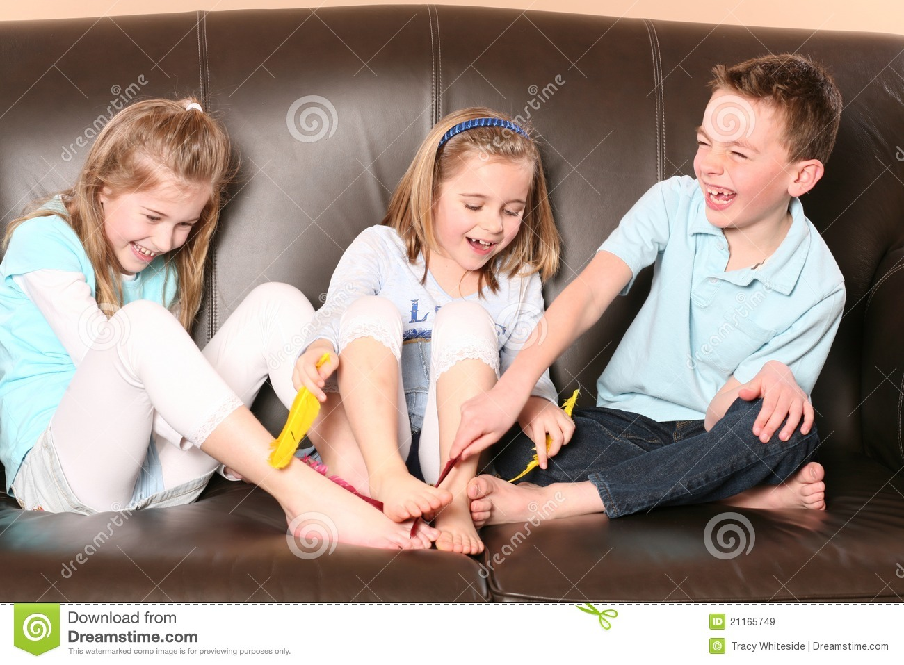 Royalty Free Stock Images: Children tickling feet with feather