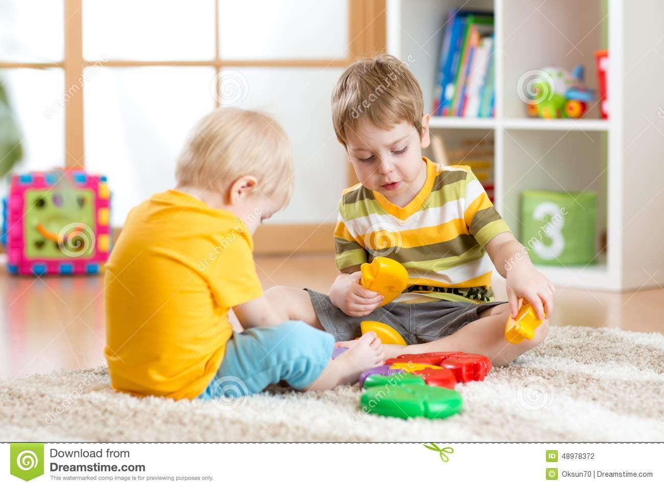 Educational Toys Nursery : Children with toys in playroom stock photo image