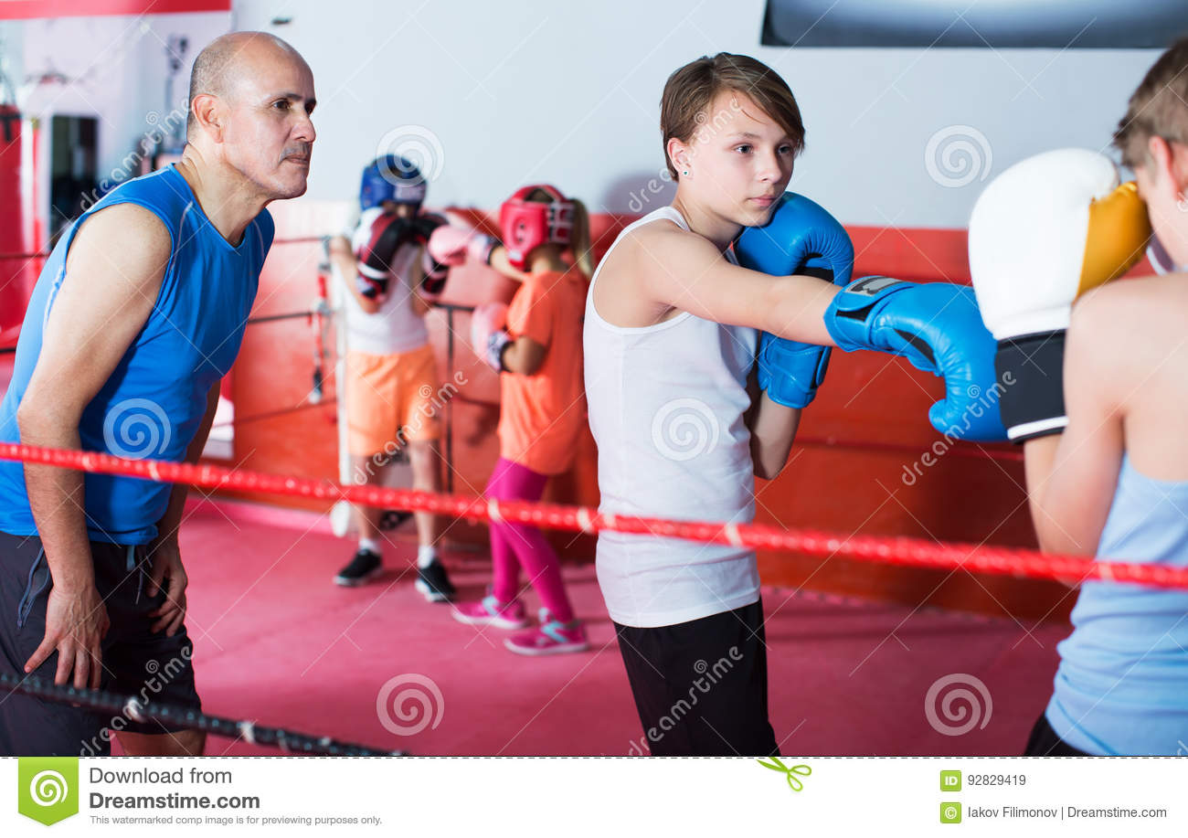 Children Training On Boxing Ring Stock Image - Image of european
