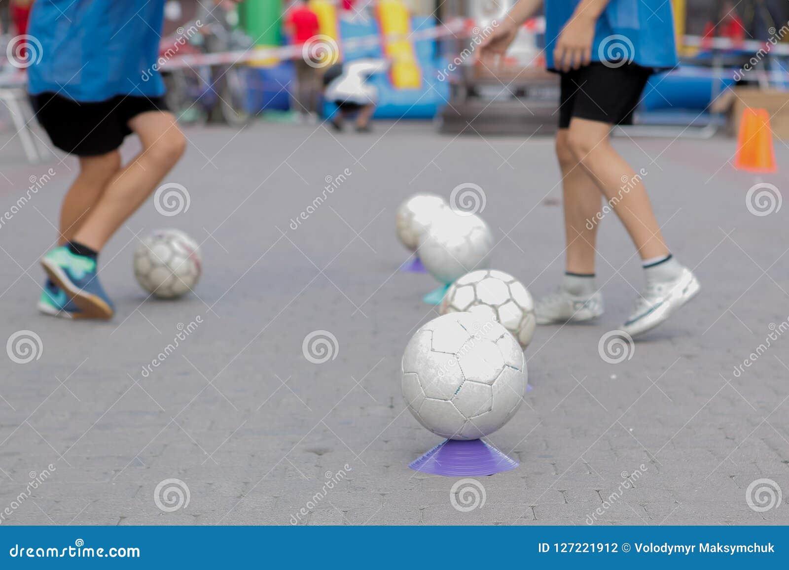 Children Training in Soccer academy, children`s training with balls