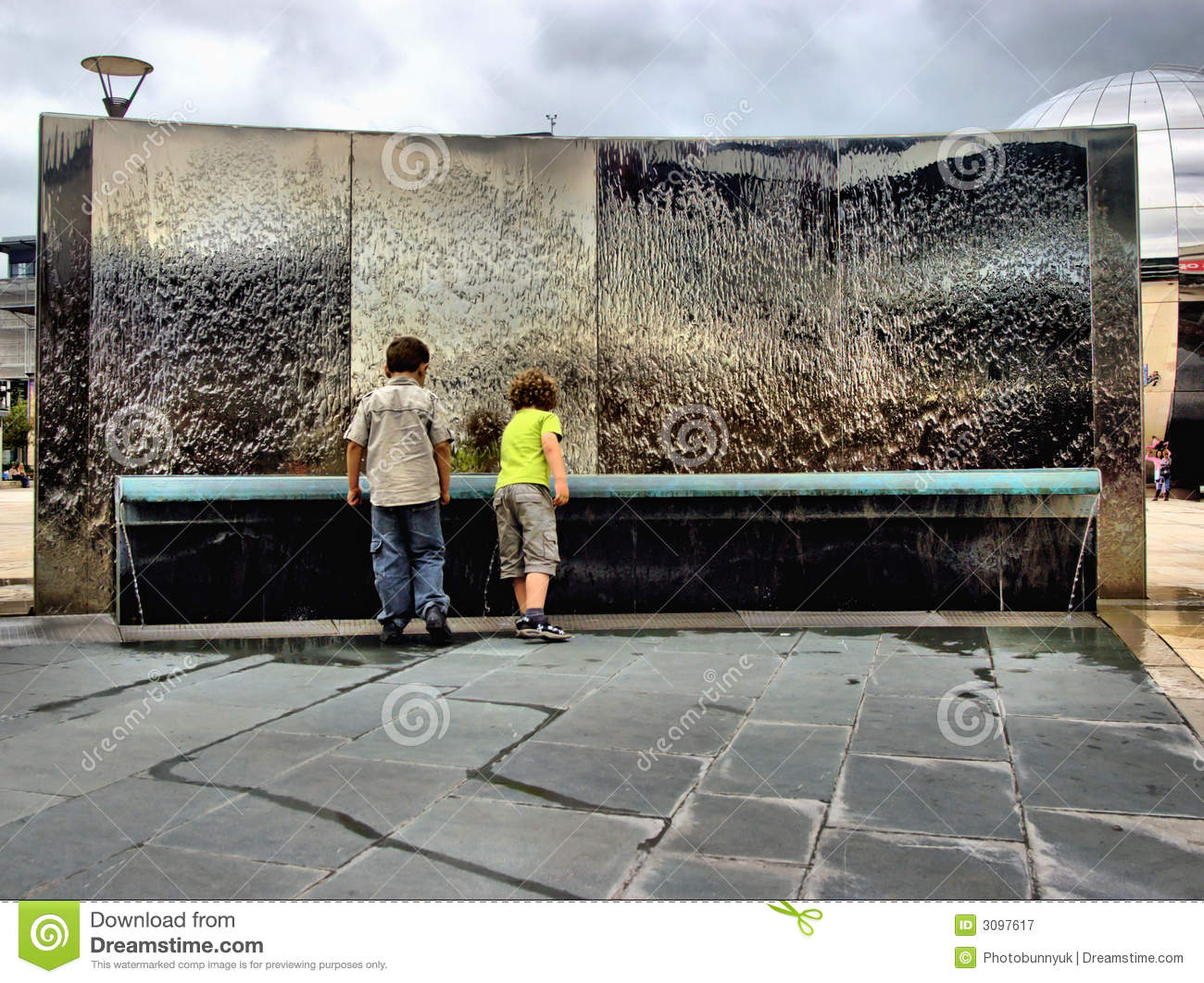 Children by water feature