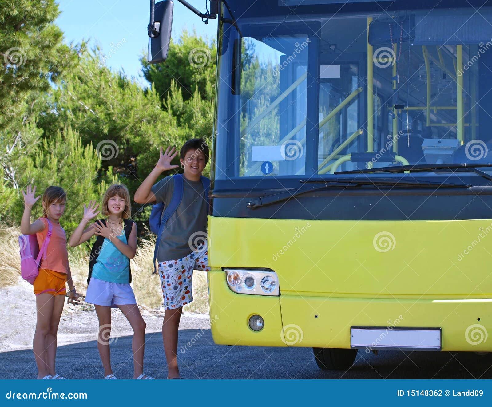 Children and yellow school bus