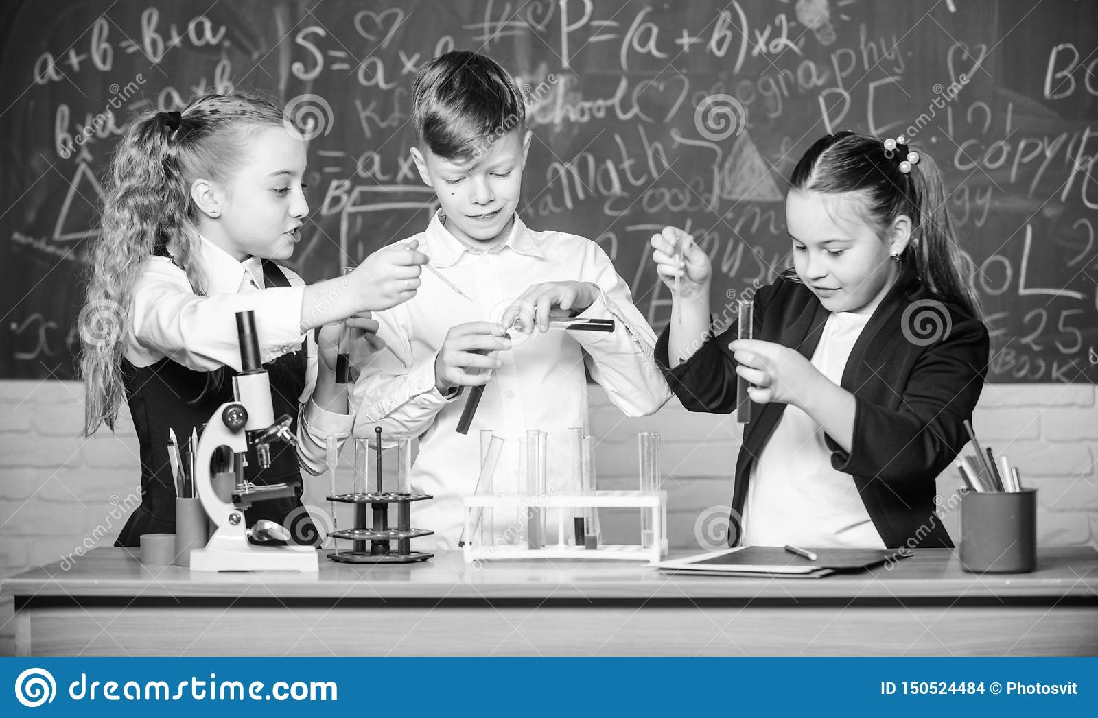 Childrens day. Chemistry. Back to school. students doing biology experiments with microscope. Little kids learning