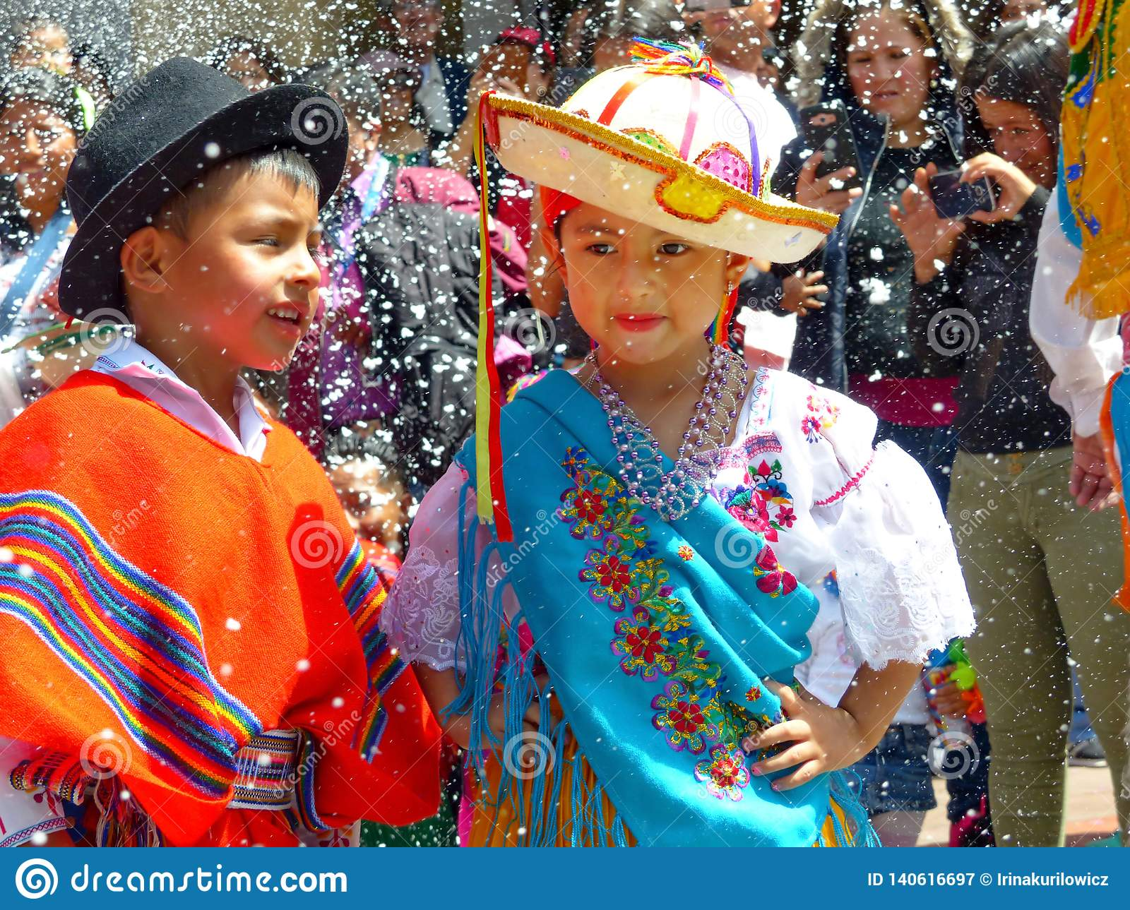 Childrens dressed in typical costumes of Ecuador dancing at the parade.